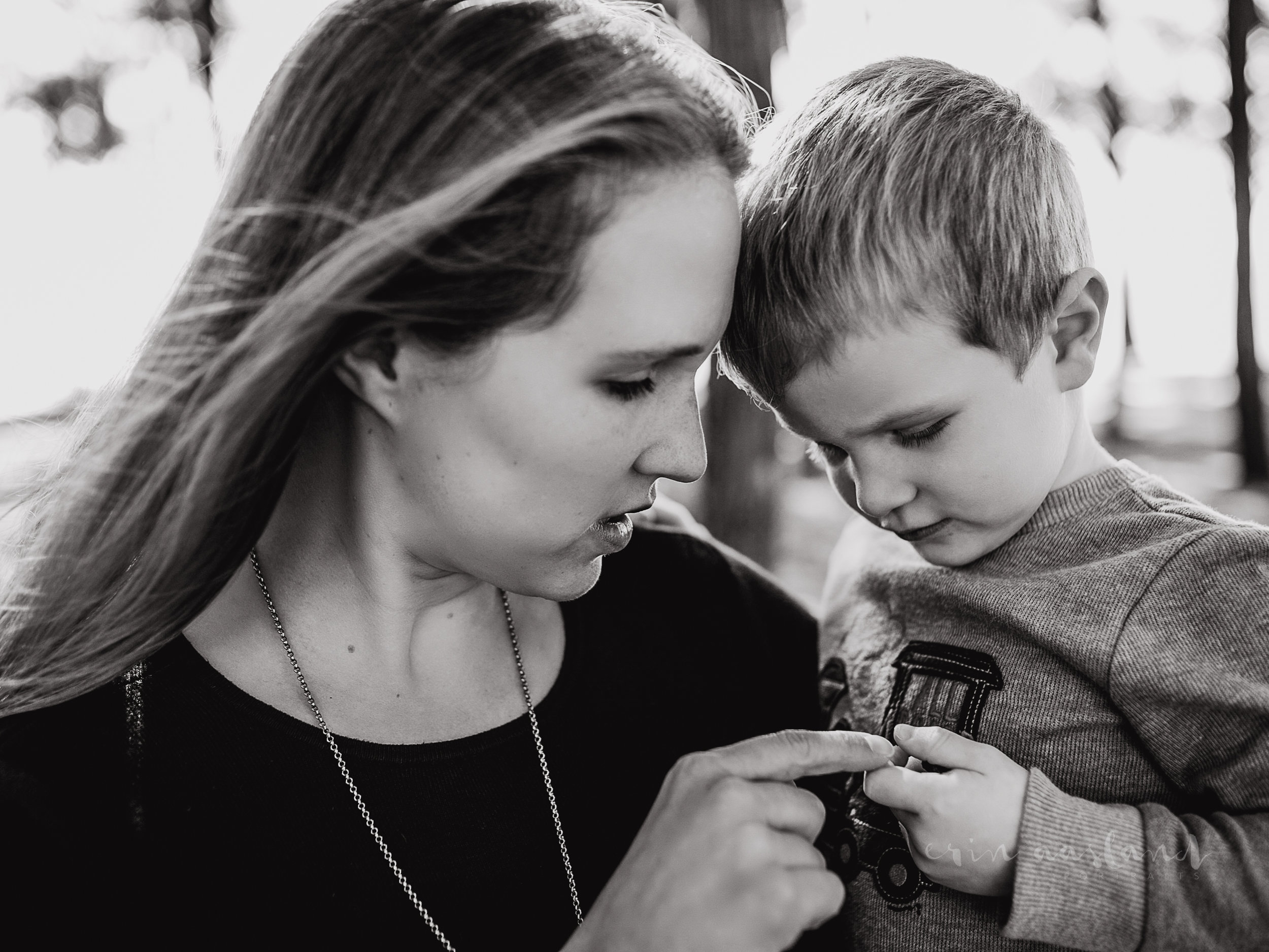 Mother and Son looking at flower
