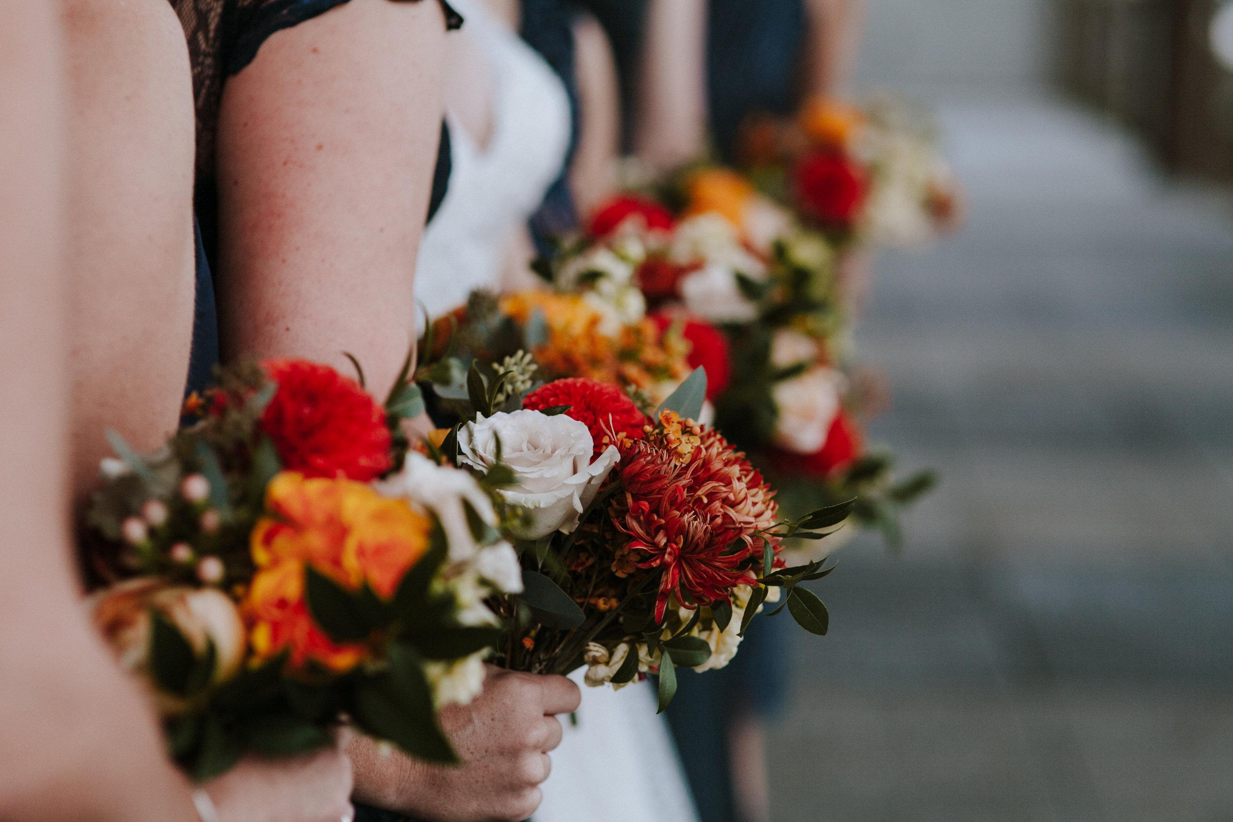 wedding bouquets red, yellow, orange, berries roses