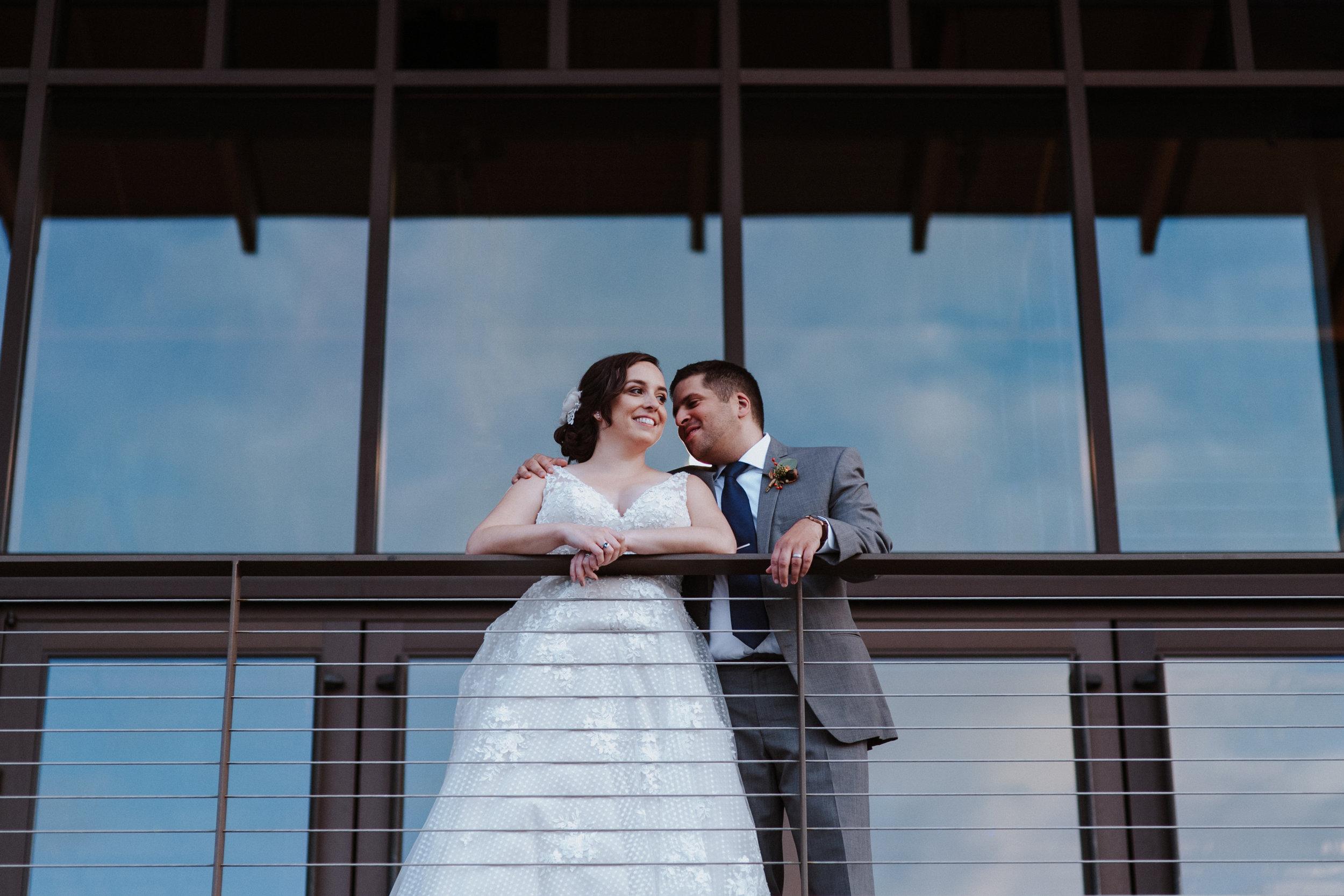 Bride & groom on balcony at Rosehill Community Center