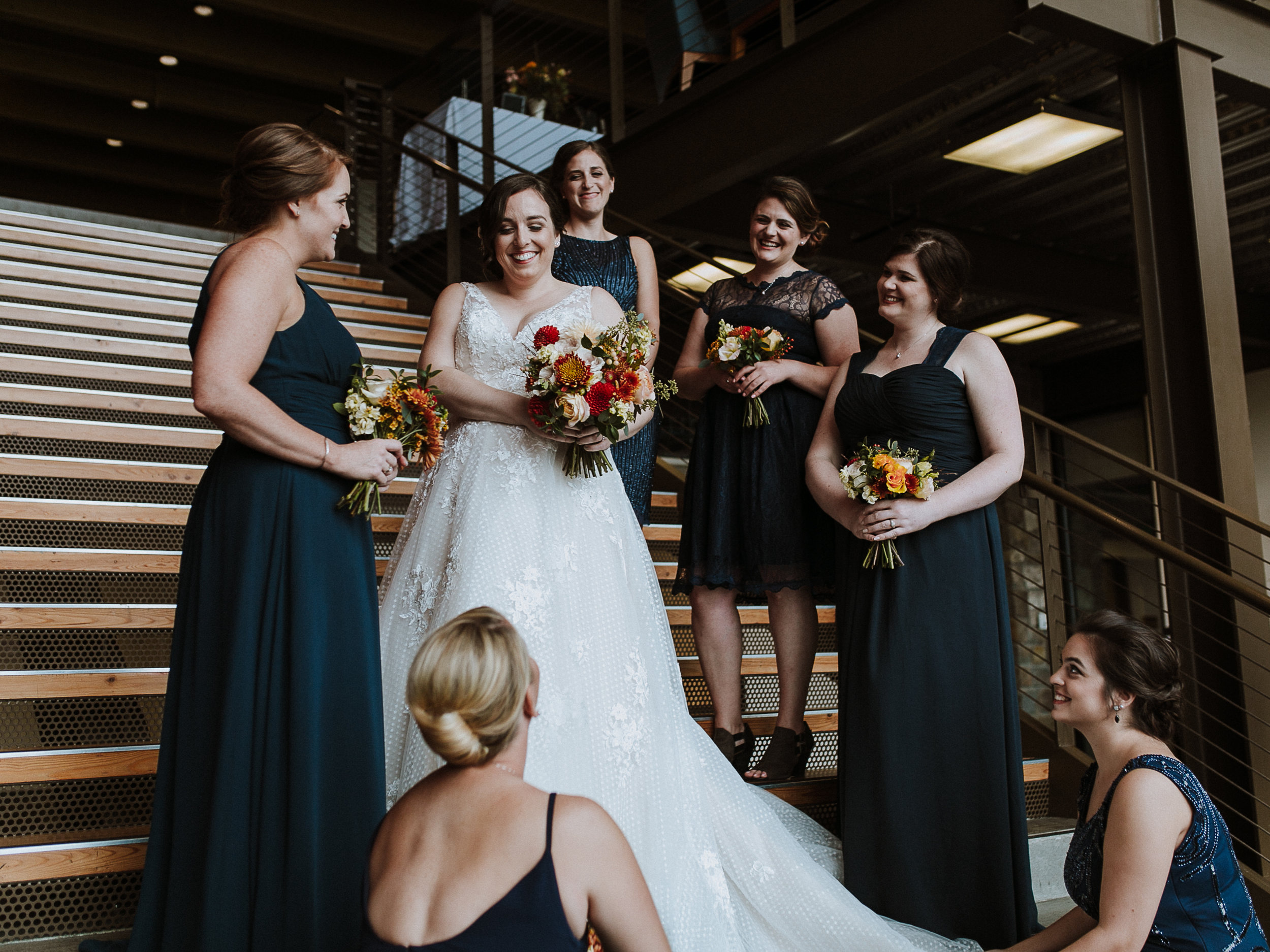 bridal party on steps of rosehill community center
