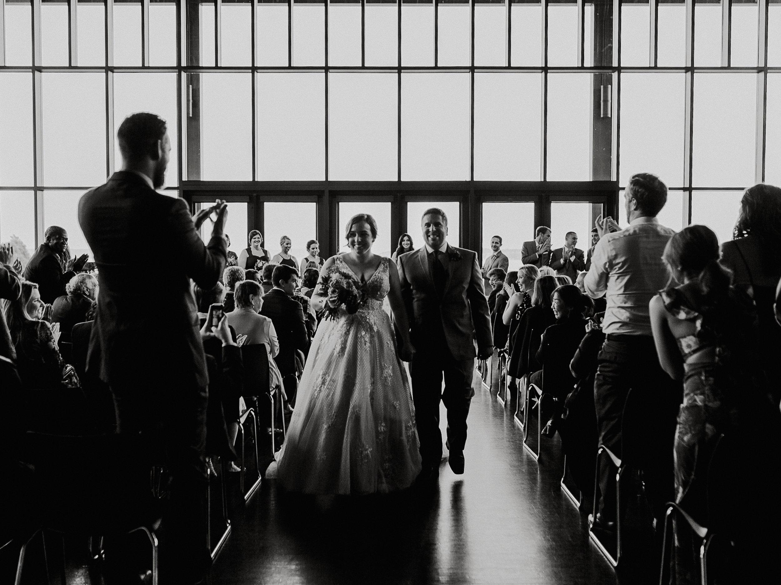 Bride & groom walking down aisle Rosehill