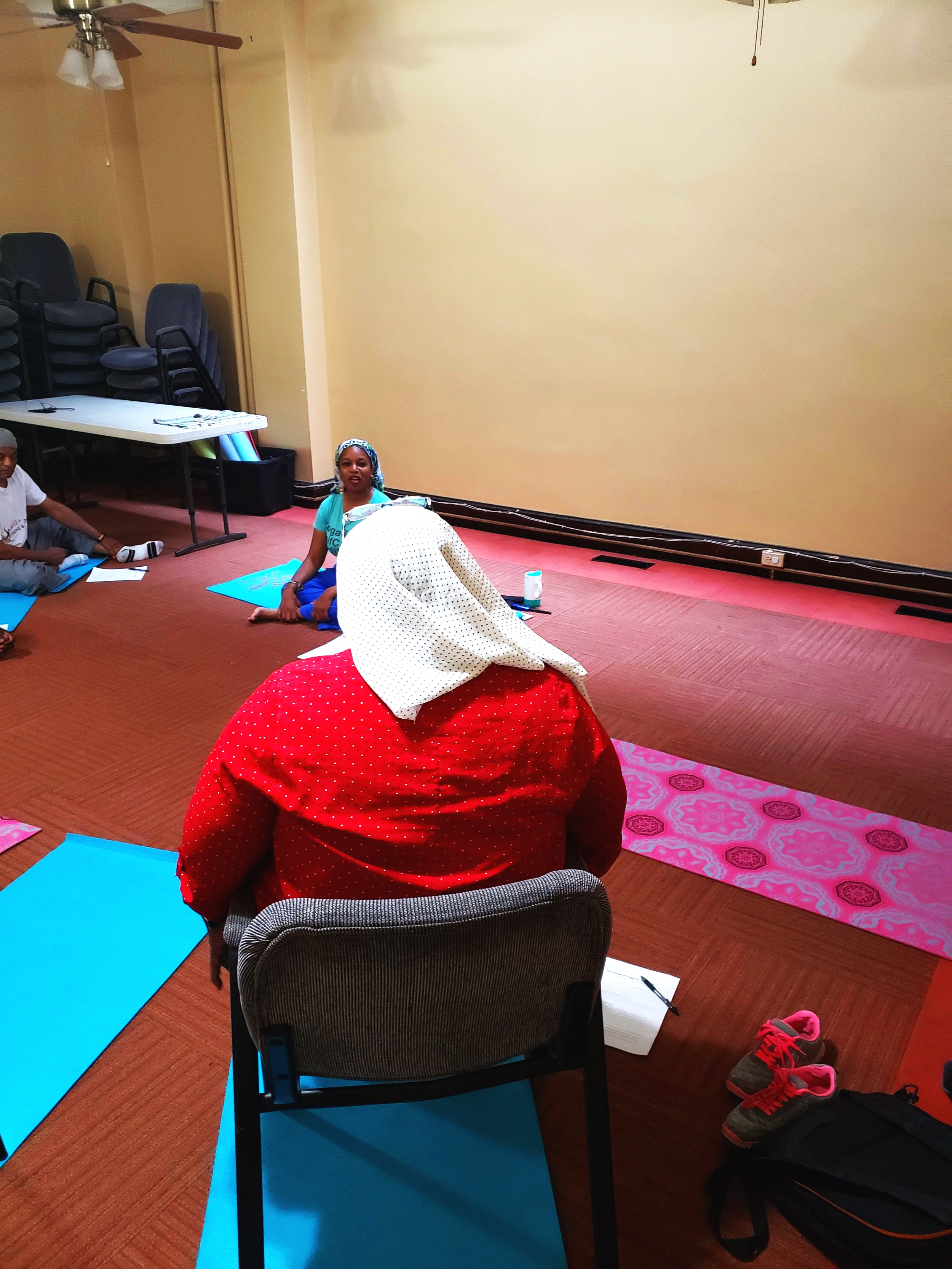 Nazaahah Amin, founder of  Ama Wellness  leading an Interactive Yoga Session