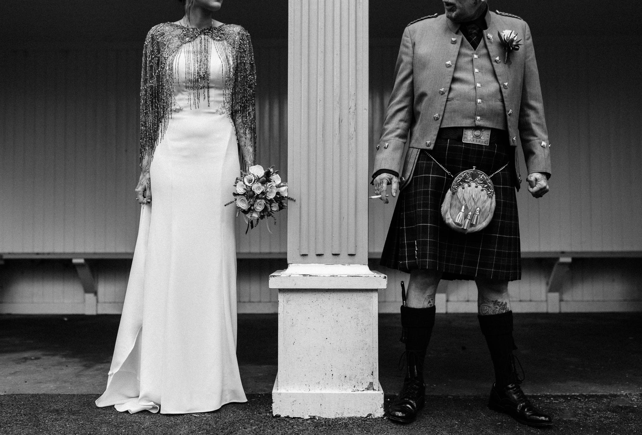 Fiona & Stix - Marischal Collegehttps://www.rocknrollbride.com/2019/07/til-death-do-us-part-skull-themed-tattoo-artists-wedding/