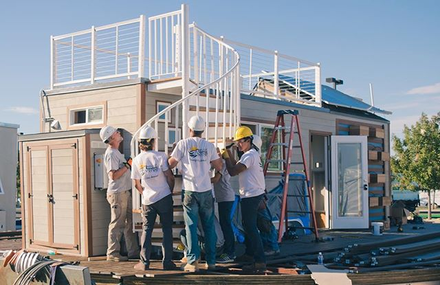 Day 2 of the competition! Our spiral staircase is in place allowing easy access to our roof deck!  #SCUTinyHouse #smud #revolve #tinyhouse #tinyhousemovement