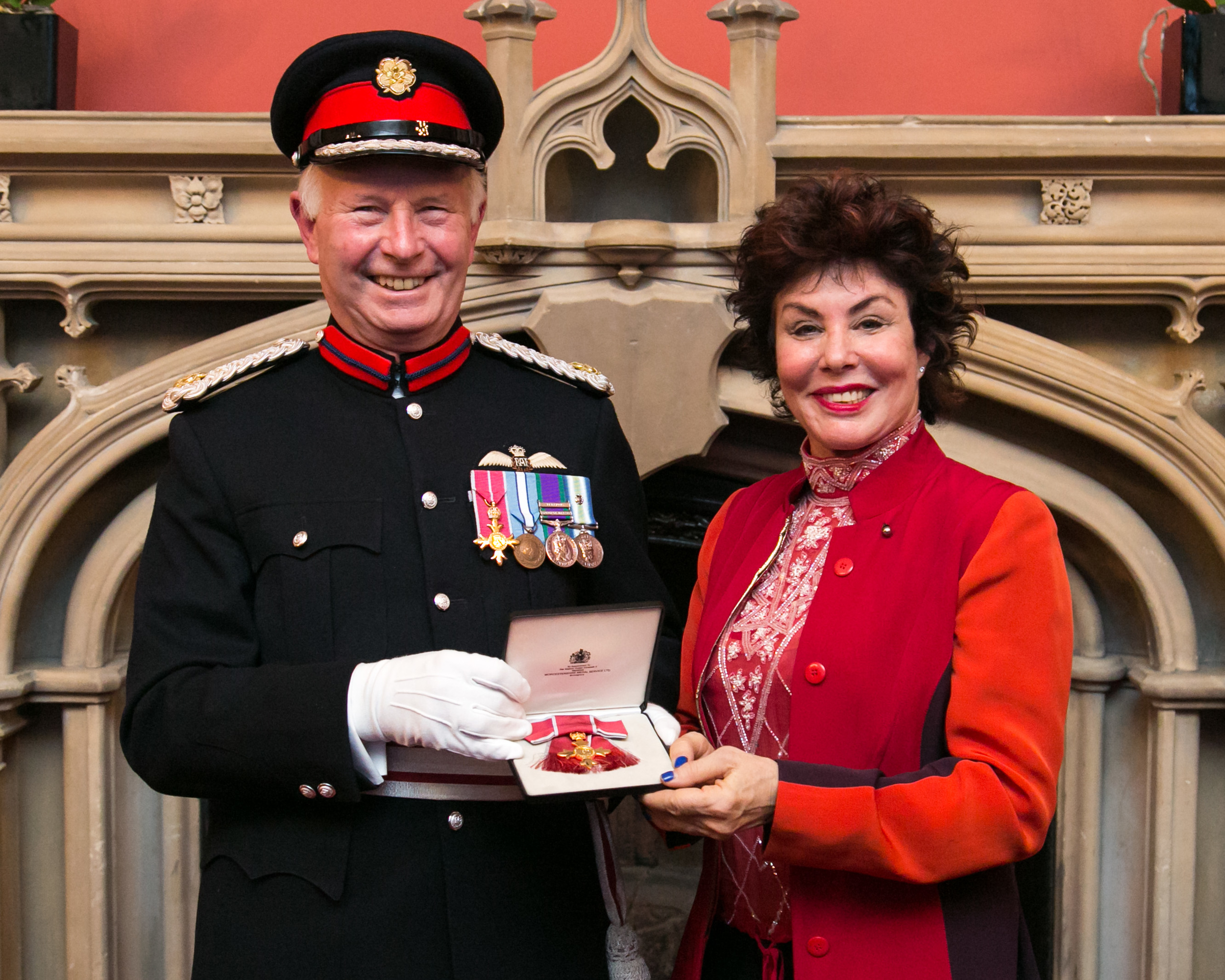 Ruby Wax receiving her OBE from Vice Lord-Lieutenant of Greater London, Mike Dudgeon