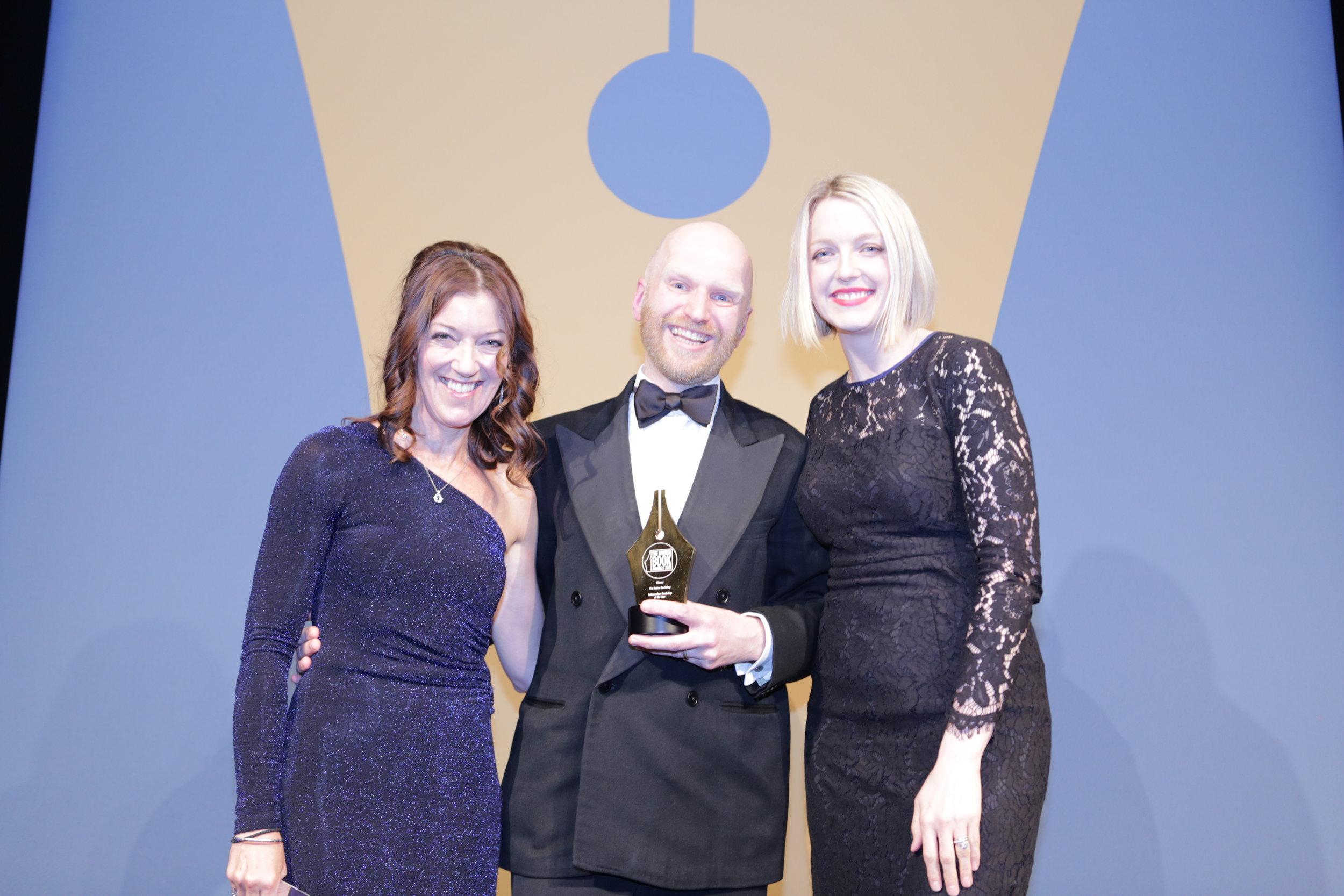 Shop owner Bob Johnston with Victoria Hislop (left) and ceremony host Lauren Laverne (right)