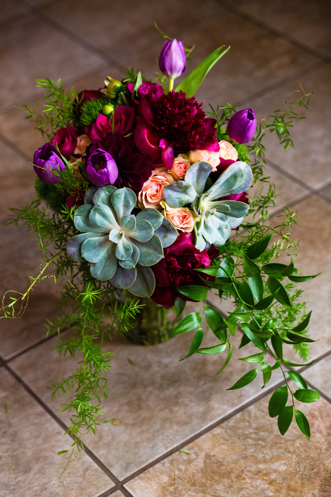 The bride's bouquet featured succulents and flowers.  Renee had a cactus theme, beautiful types, in the details of the day.