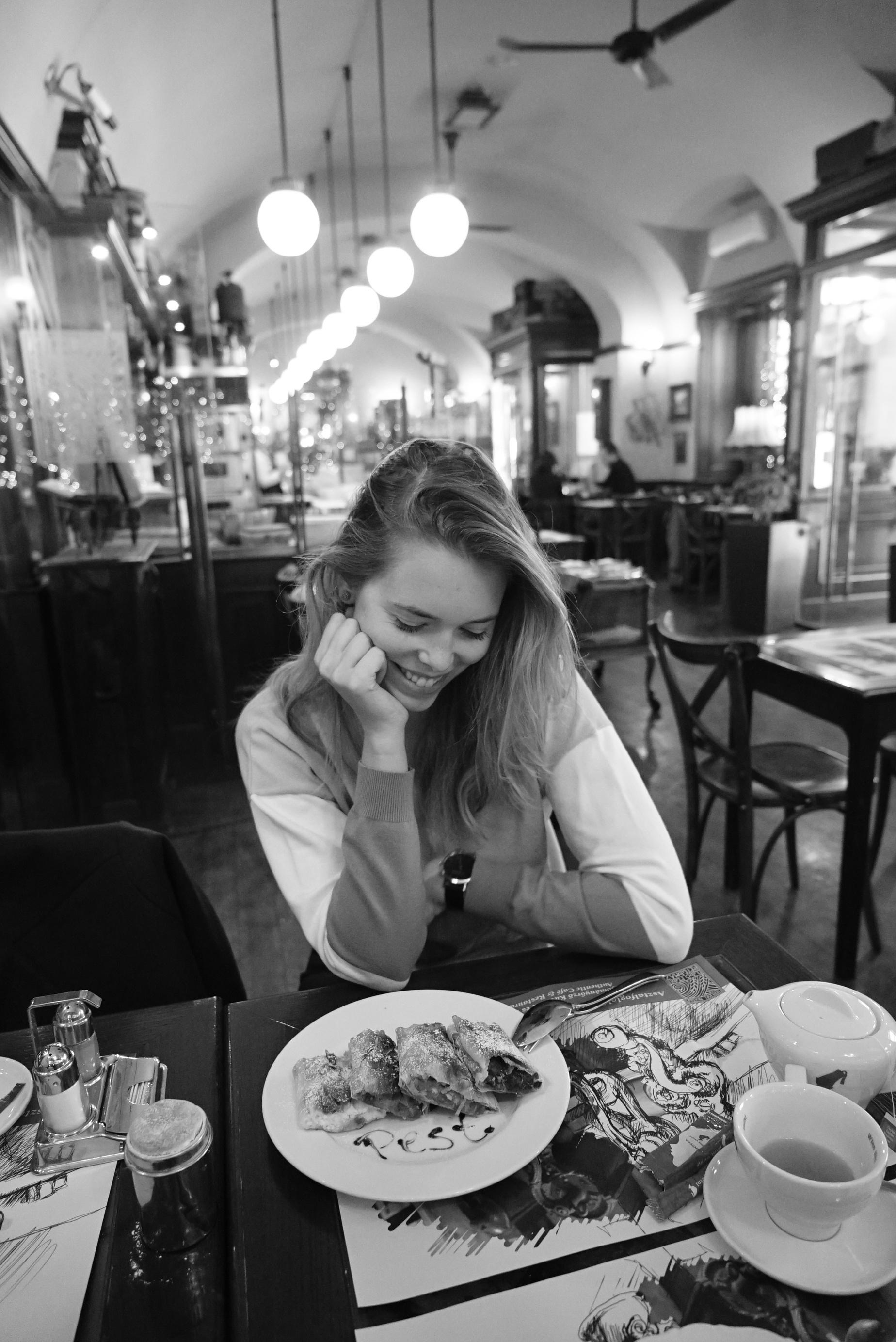 Girl eating strudel in Budapest cafe