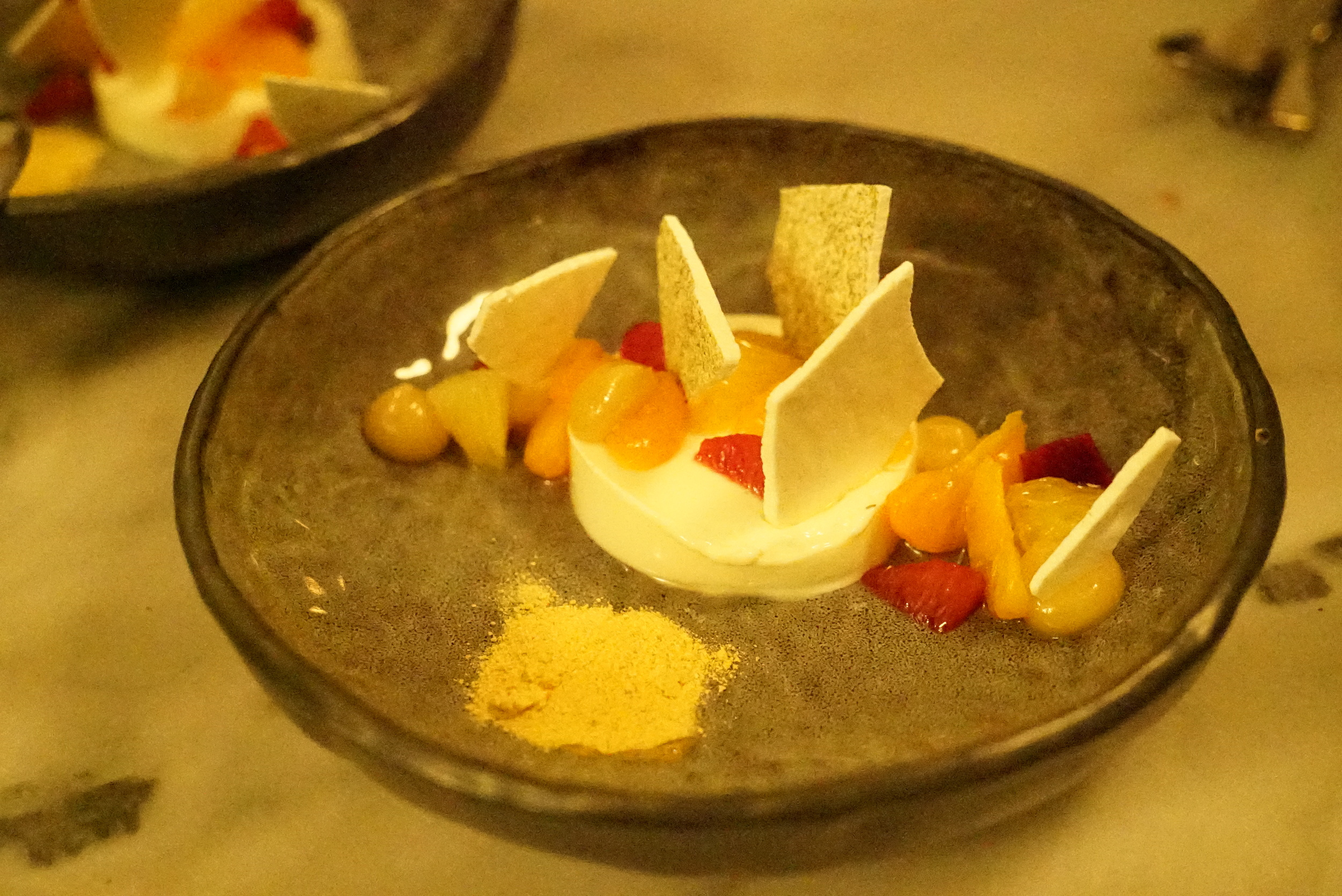 Sheep milk yoghurt and white chocolate panna cotta with citrus fruits and lemon myrtle meringue.