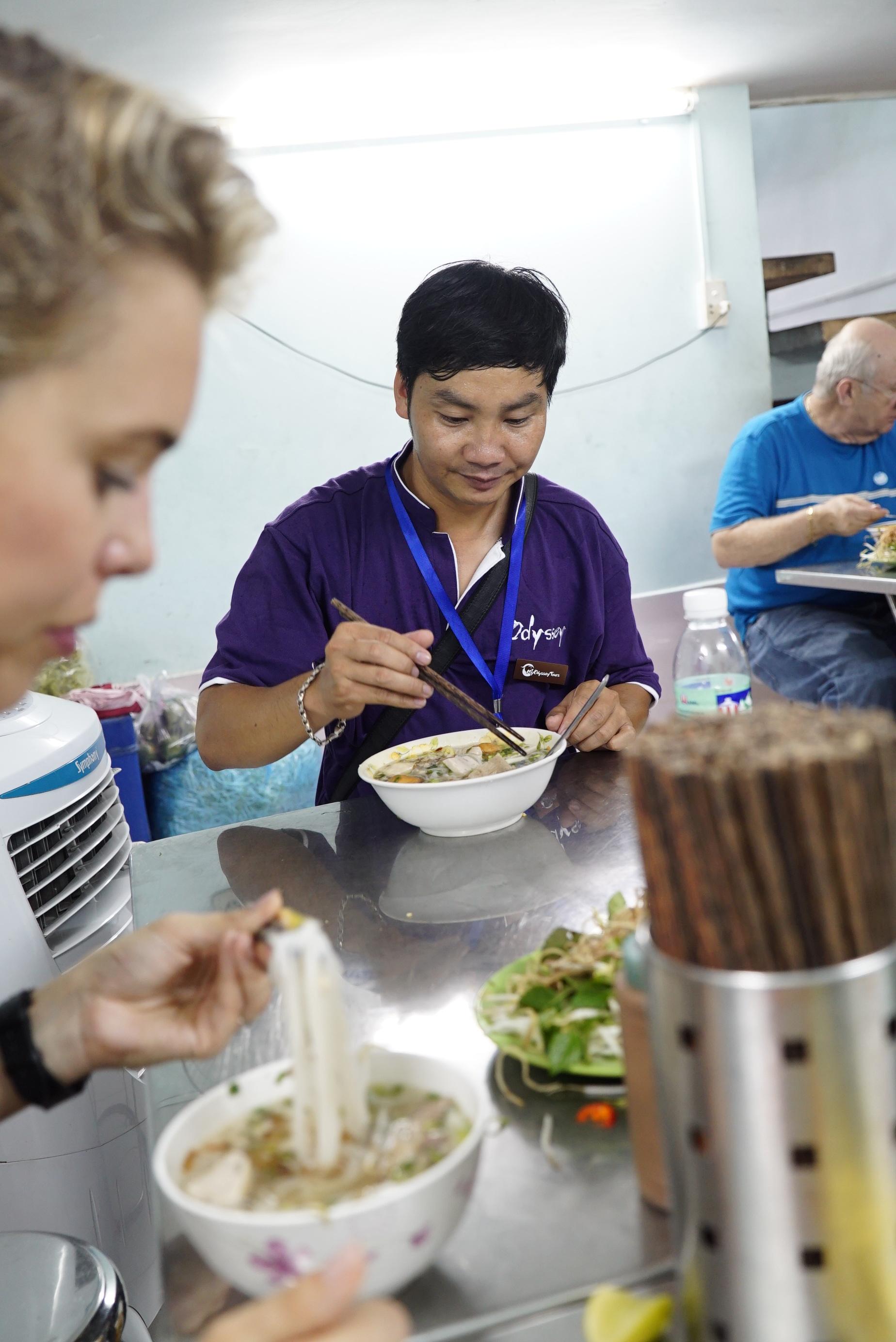 Tour Guide Eating Pho Vietnam