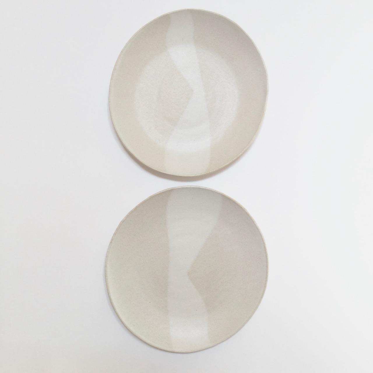 1055 Pair of white sand dinner plates top.jpg