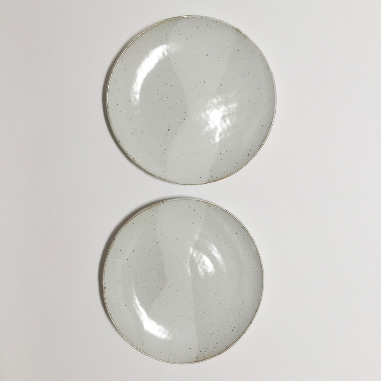 1068 Pair glossy white dinner plates top.jpg