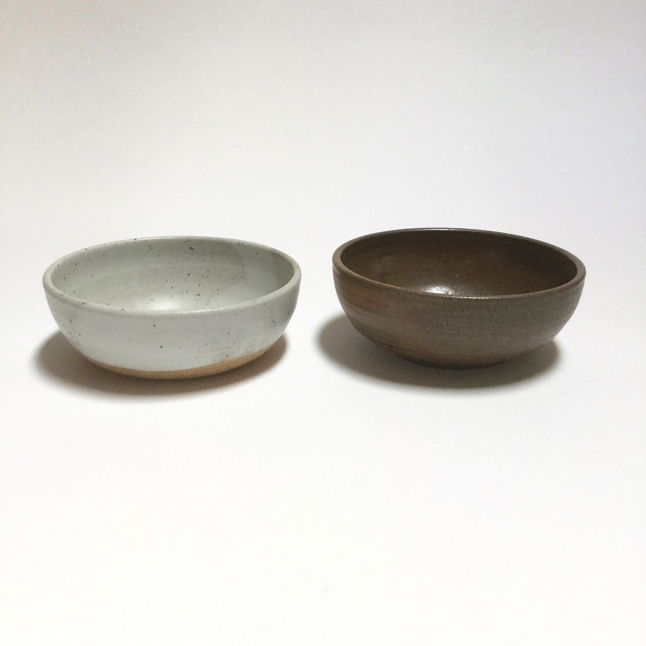 1120 Pair brown white bowls side.jpg