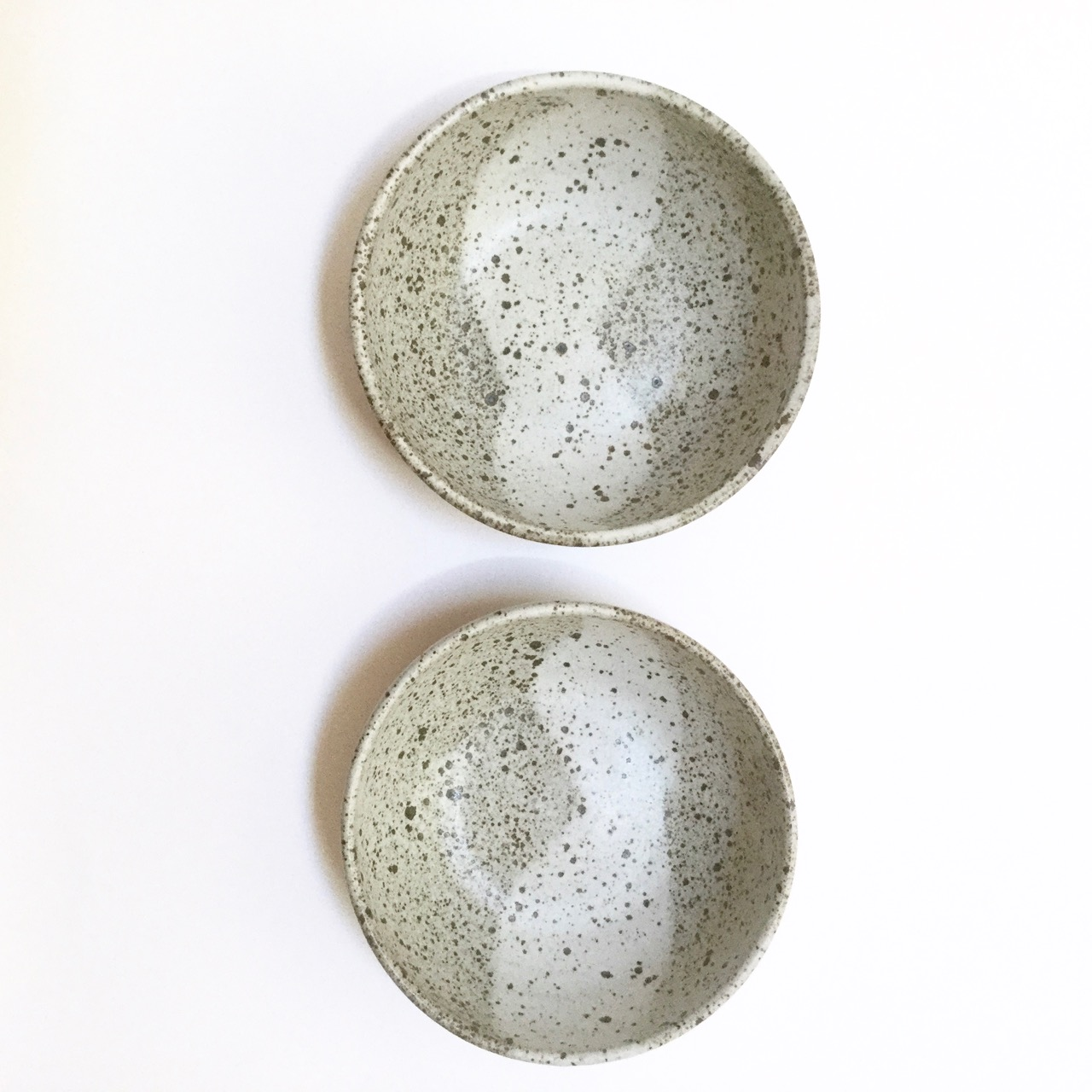 1129 Pair speckled bowls top.jpg