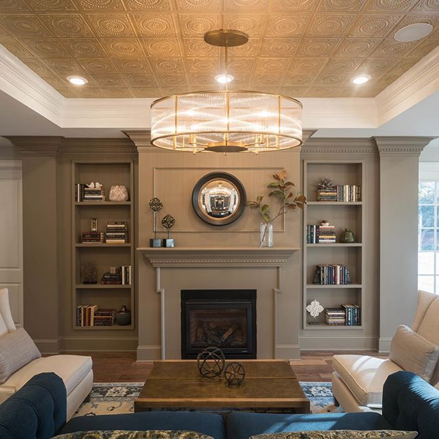 We always love a good built in, and who doesn't love a fireplace. This is the best time of year to read by the fire.  #interiordesign #builtin #commerialdesign #multifamily #bookcase #interiors #fireplace