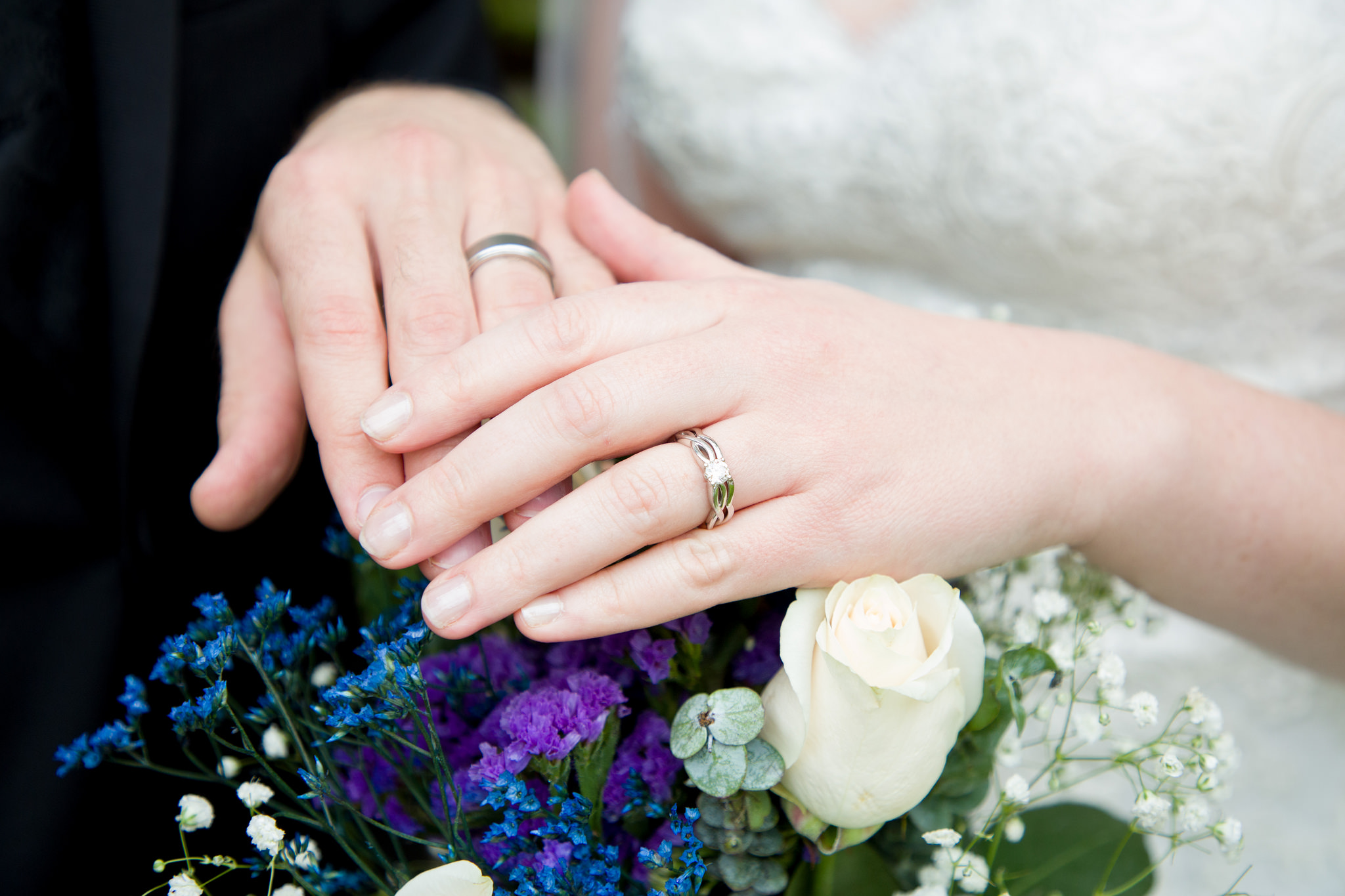 bride and groom hands wedding rings flowers coordinator philadelphia pennsylvania.jpg