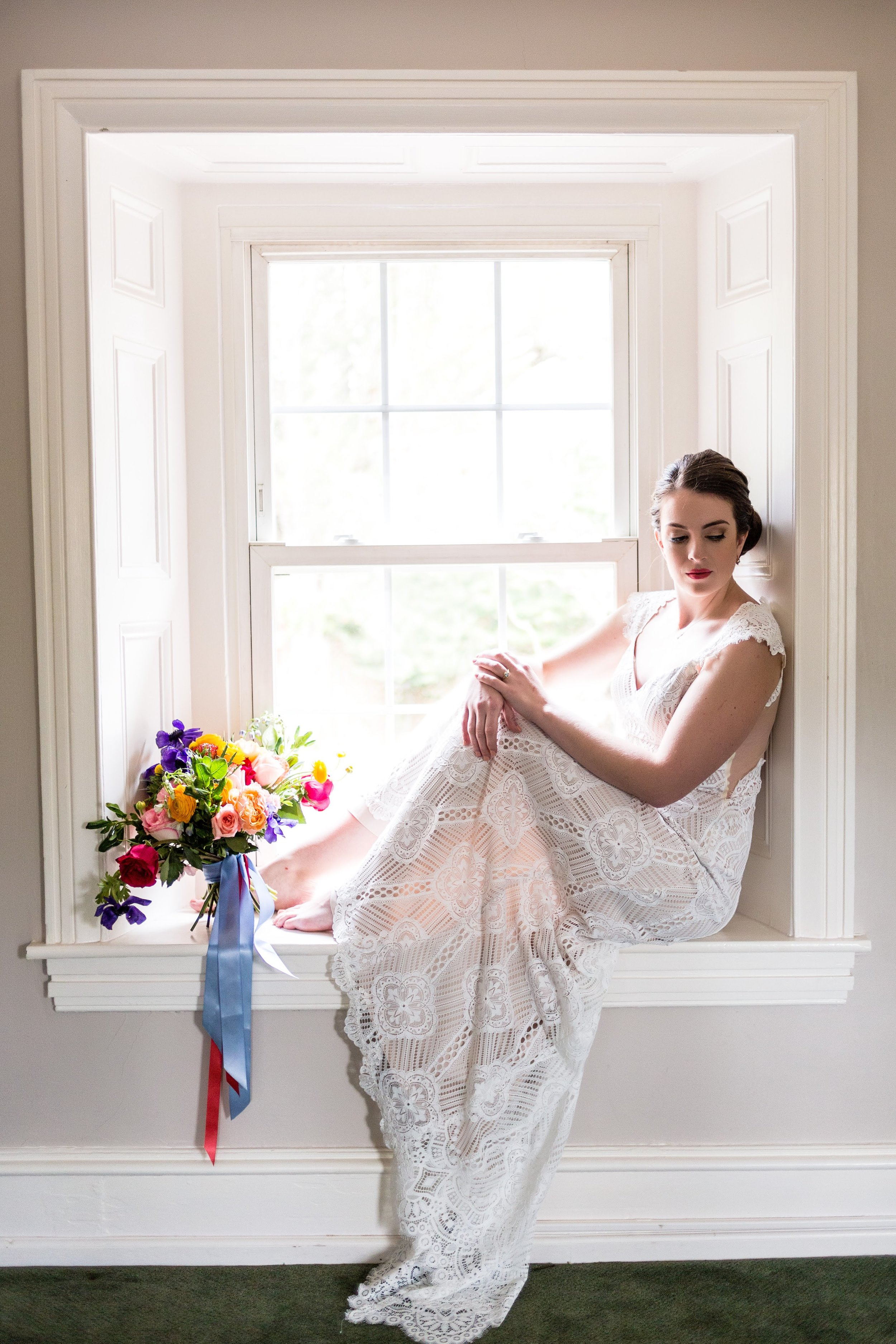 Bride in Window with Colorful Bouquet