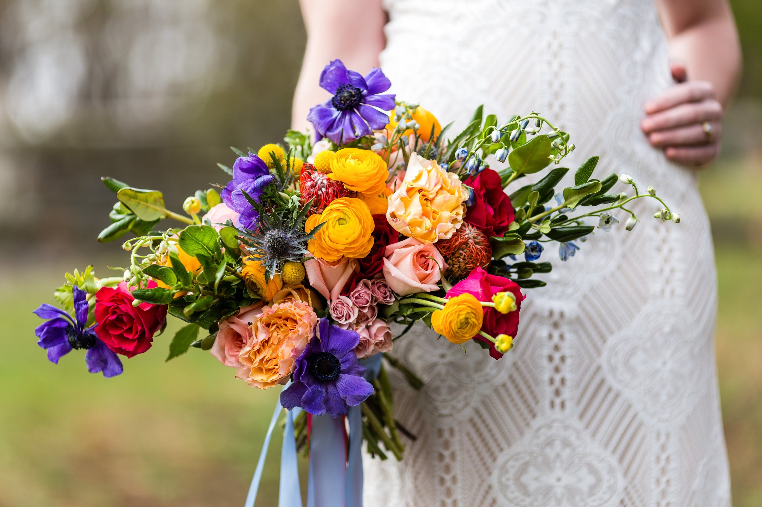 Colorful bridal bouquet Lavender Lilacs and Love Claire Pettibone Romantique Nicole Bridal and Formal Wedding Dress Ashley Gerrity Photography