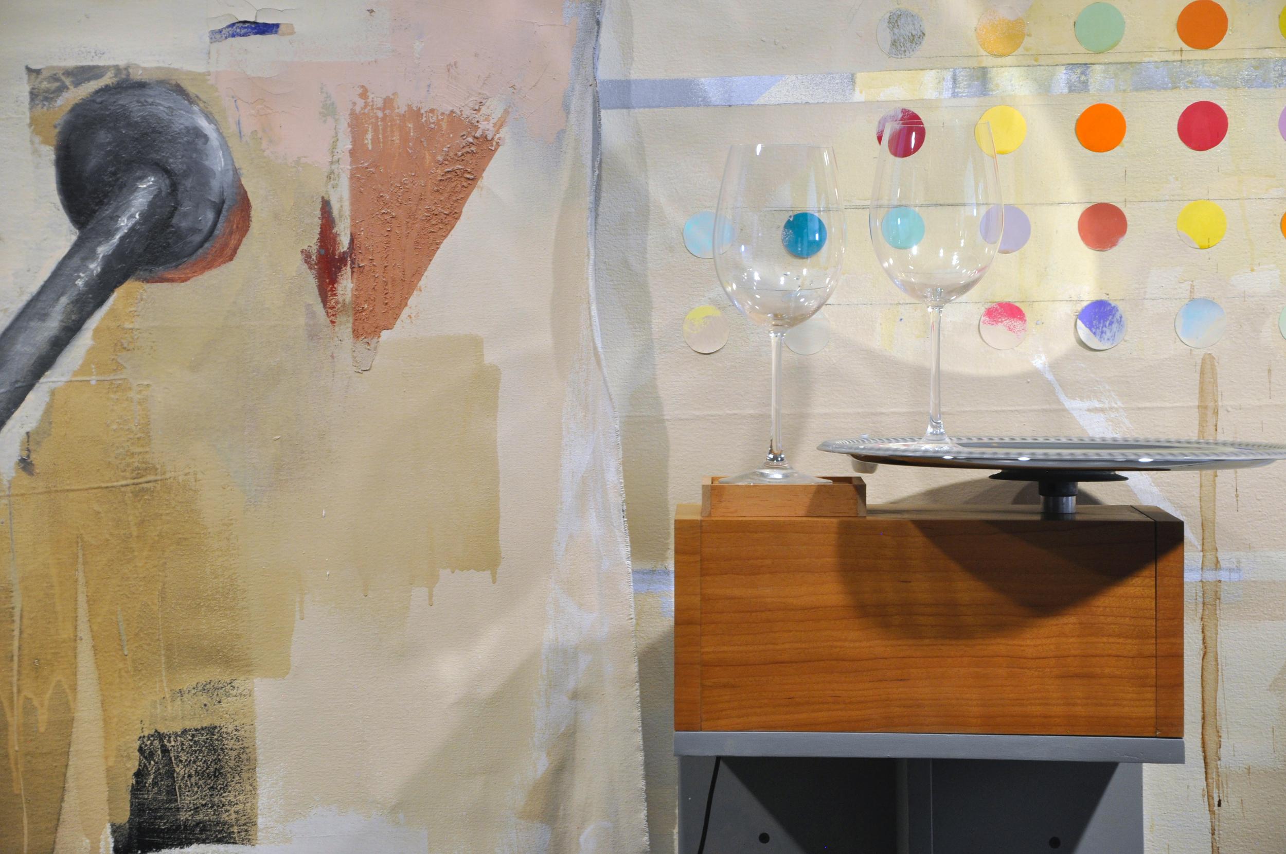 2016 , walnut veneer, MDF, DC motor, chrome platter, wine glasses, oil on canvas, sheetrock, joint compound