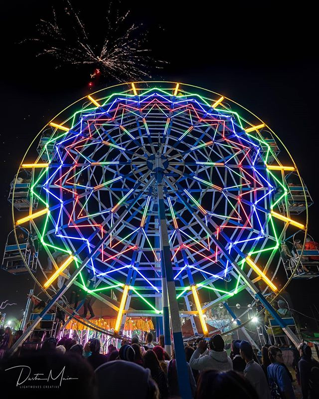The Wildest Ferris Wheel  Adorned in neon lights, yet powered by humans, this is the ferris wheel that rules in Myanmar  Imagine for a moment, powering through the crowd for a seat.  There are no formal lines here.  Drop your 1500 kyat (~$1USD) in the hand of the person who looks like they're in charge of the chaos and hop on.  Seriously, there is no time to waste  Young guys, maybe a dozen or so, work the ferris wheel, both as ground control and above.  Yes, above  Seated on your little seat, perhaps sharing with one and facing two others, you nod.  You're all in this together now.  You're moving up as they let the people in the next pod hop off, and new customers hop on.  You look up, and there are a couple of guys in flip flops, standing on the inside of the ferris wheel.  They move along the internal frame of the wheel, shifting the weight and causing the wheel to turn slightly so people can disembark and refill  Soon, you're at the top of the wheel, looking out over the festival grounds where thousands of people have gathered.  You look around to the other passengers, waiting for the look of excitement about what's to come to show on their face.  Usually, it's like a light form of terror instead.  What have you gotten yourself into?  Too late for that now  A whistle blows, and you look down.  6-8 of these flip-flop wearing young men quickly scale the ferris wheel, careful to do it all at the same time.  Then, when they are all in place, another whistle is blown and they all shift to one side, and their weight causes the wheel to begin to turn  To be continued tomorrow  #UnTourToMyanmar #ThisMyanmarLife #Taunggyi #Tazaungdaing #fireballoon #ferriswheel #Myanmar #burma #shanstate #neonlife #MyMyanmar #MyanmarMagic #tbscommunity #bbctravel #documentary #nightlife