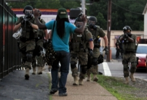 Protester in Ferguson, MO in August 2014 (photo by Jeff Robertson)