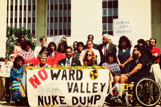 Colorado River Native Nations Alliance (CRNNA) activists along with Reverend Jesse Jackson conduct a spiritual vigil at the LA Federal Building on December 14, 1995. Photo: Phil Klasky