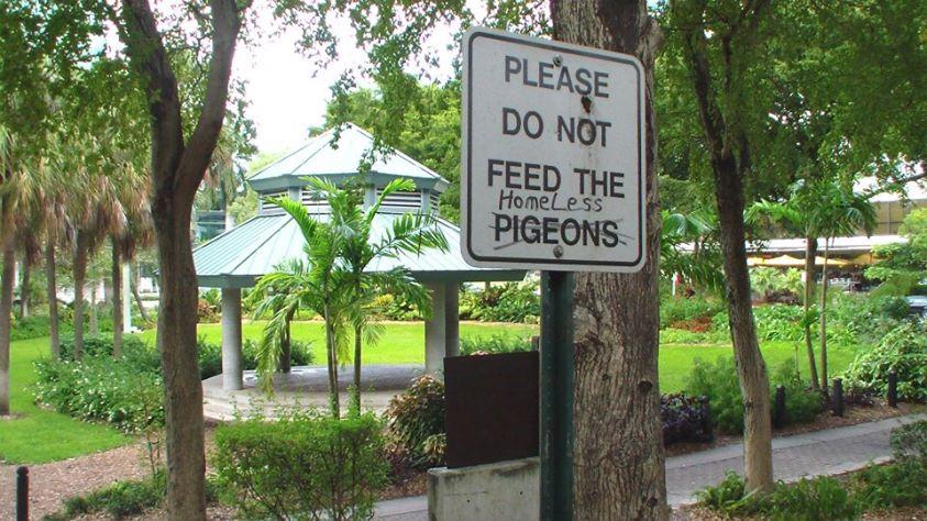 Don't Feed the Homeless Sign at Stranahan Park