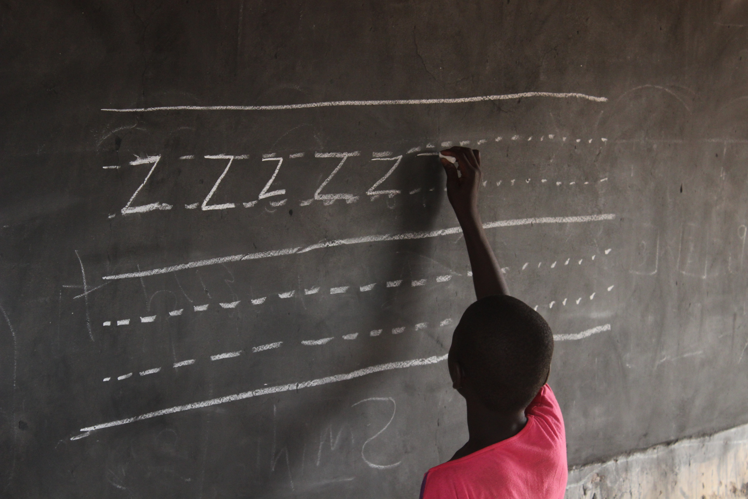 An out of school Ghanaian girl attends a Complementary Basic Education program that aims to provide accelerated literacy and numeracy. The ultimate goal is for her to transition into formal schooling after completing the 9-month program. Credit: Brendan Rigby