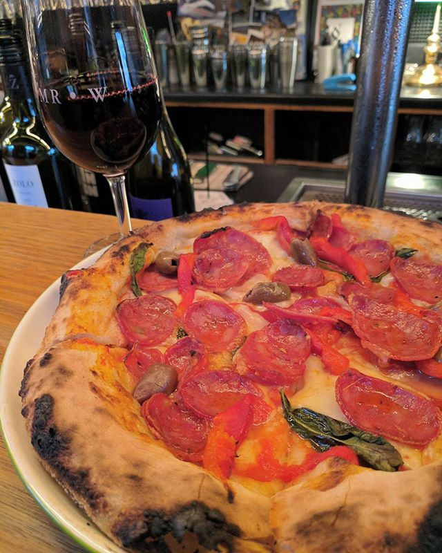 Its warm and toasty inside with a salami pizza and sangiovese combo.