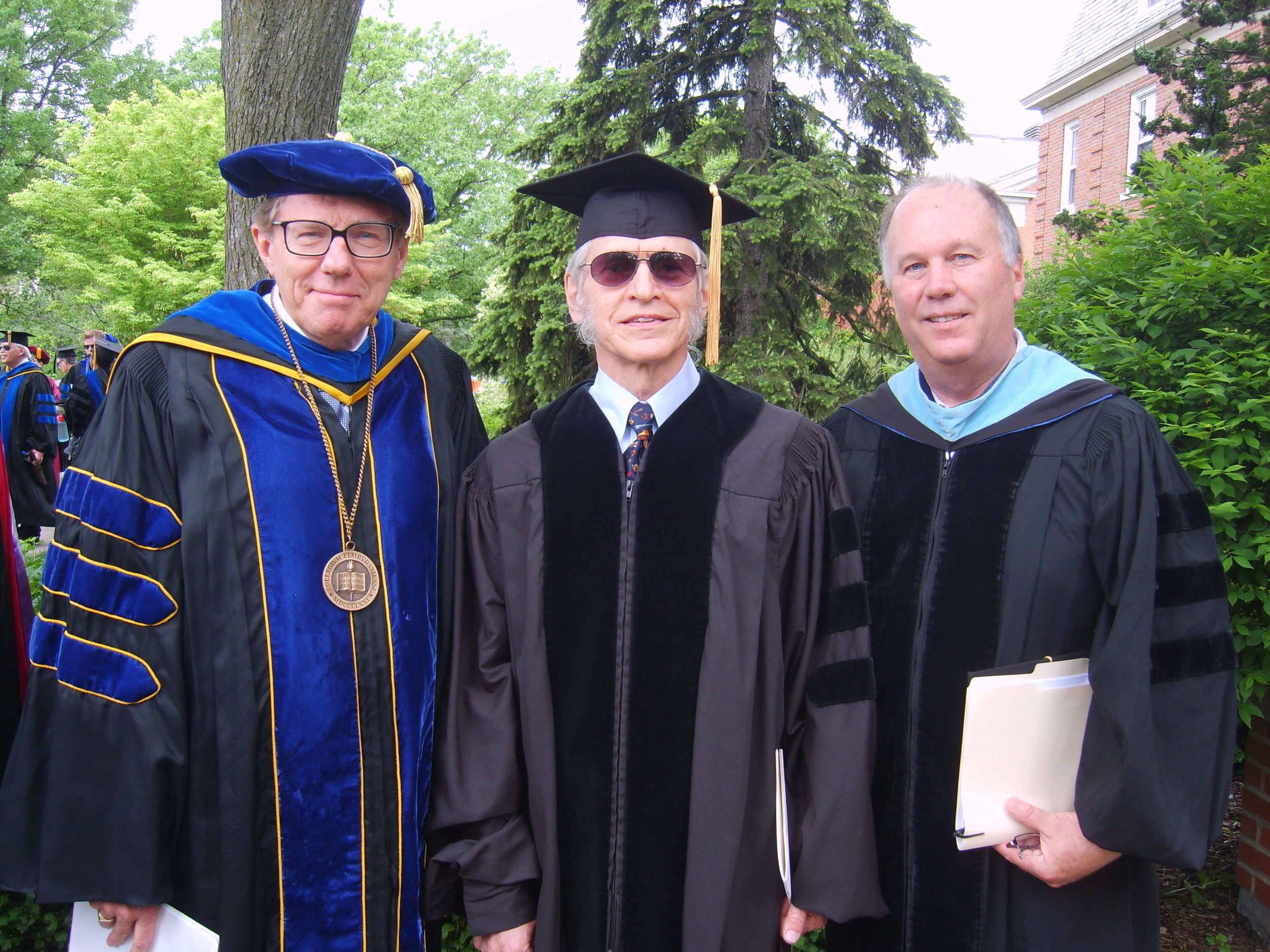 Fred Gretsch is flanked by Elmhurst College Interim President Larry Braskamp (left) and Music Department Chair Peter Griffin.