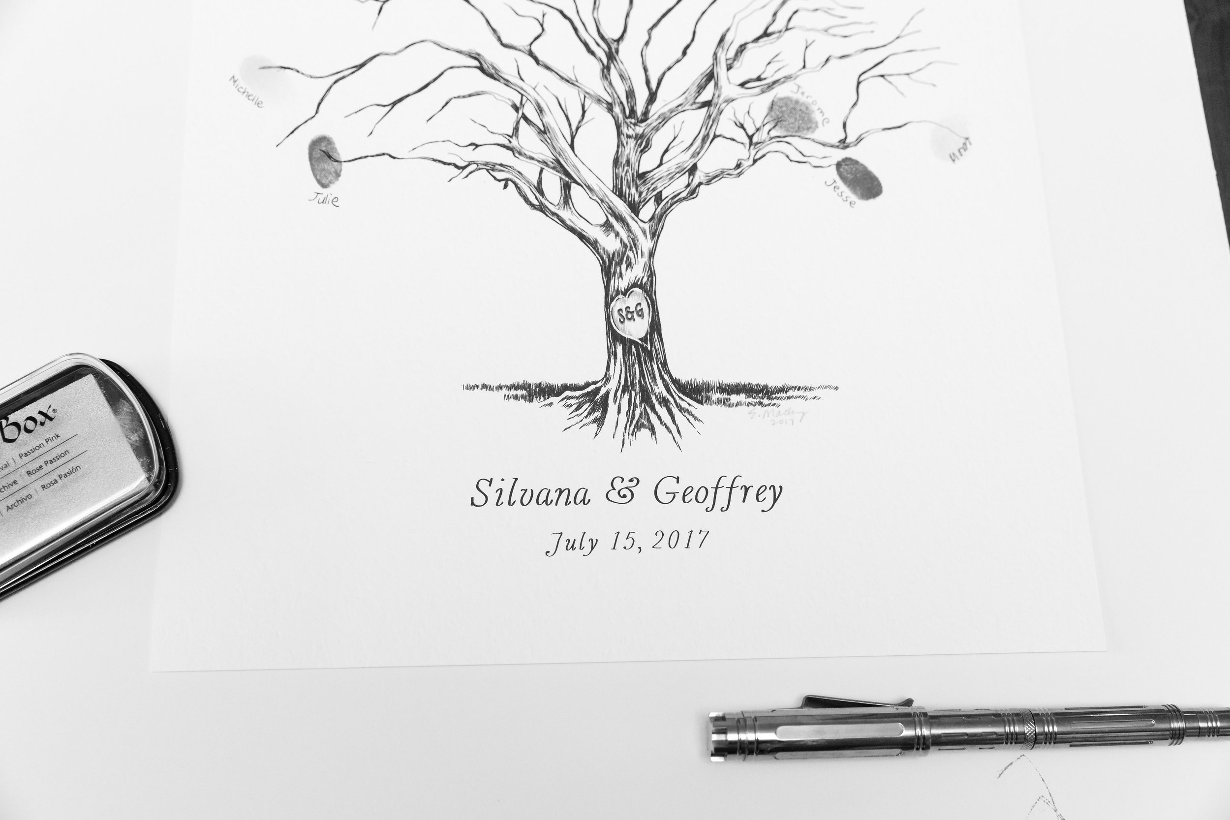 """Loved this creative way for guests to """"sign-in"""". Guests left their fingerprint on a branch of the tree and signed their name for Silvana and Geoffrey to remember."""
