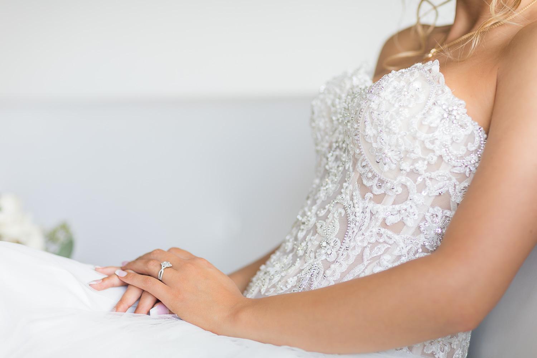 Bride Getting Ready sitting in wedding dress LA Photography.jpg