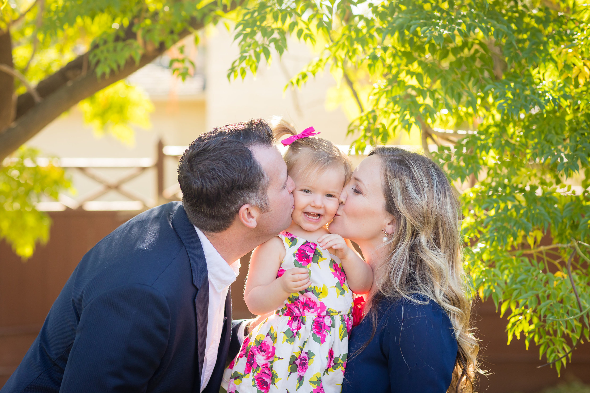 Parents loving on their daughter in Long Beach at Family Photo Session.jpg
