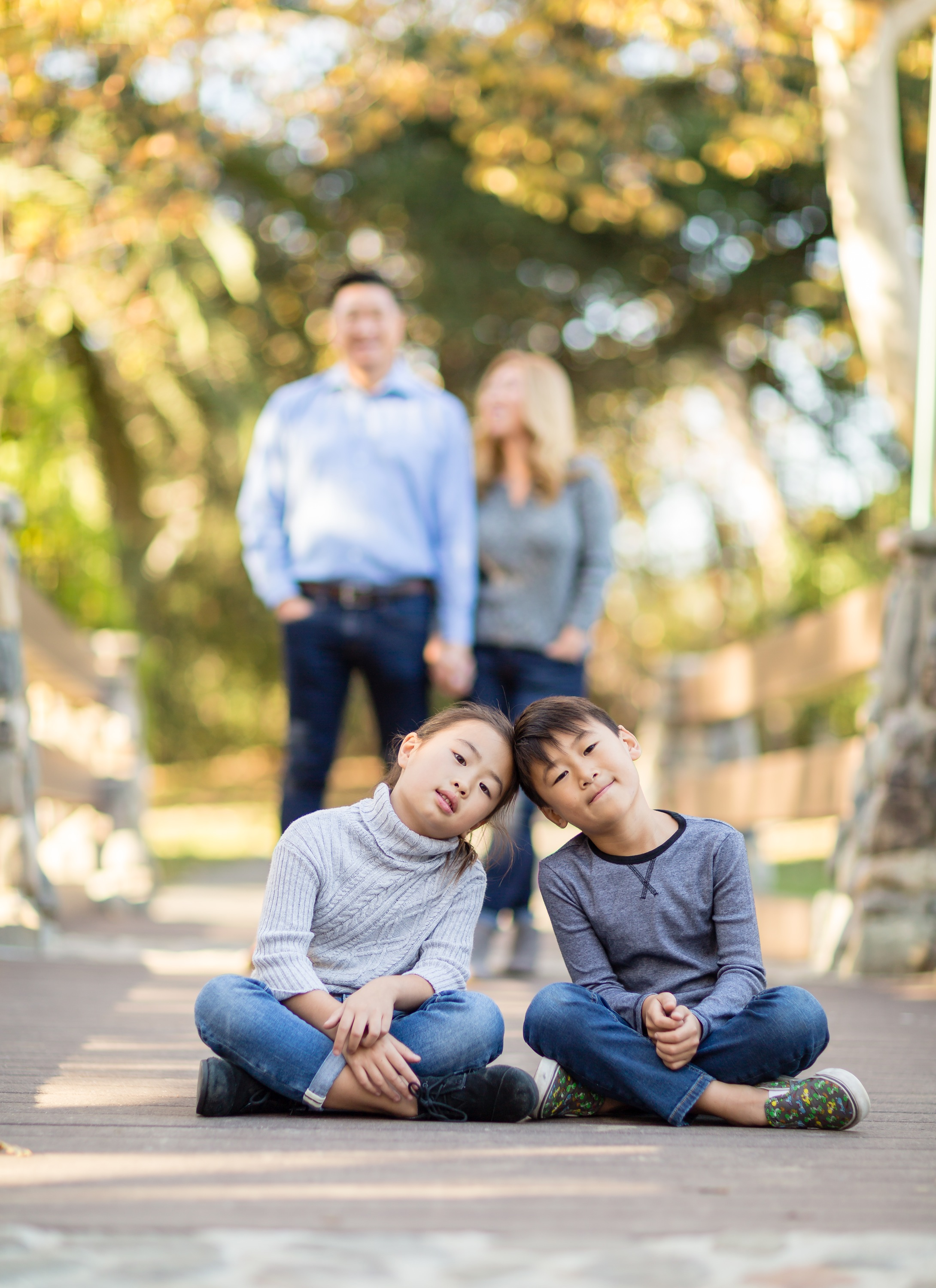 Family Portrait Kids Sitting in Front Parents Standing in Background Irvine Regional Park.jpg