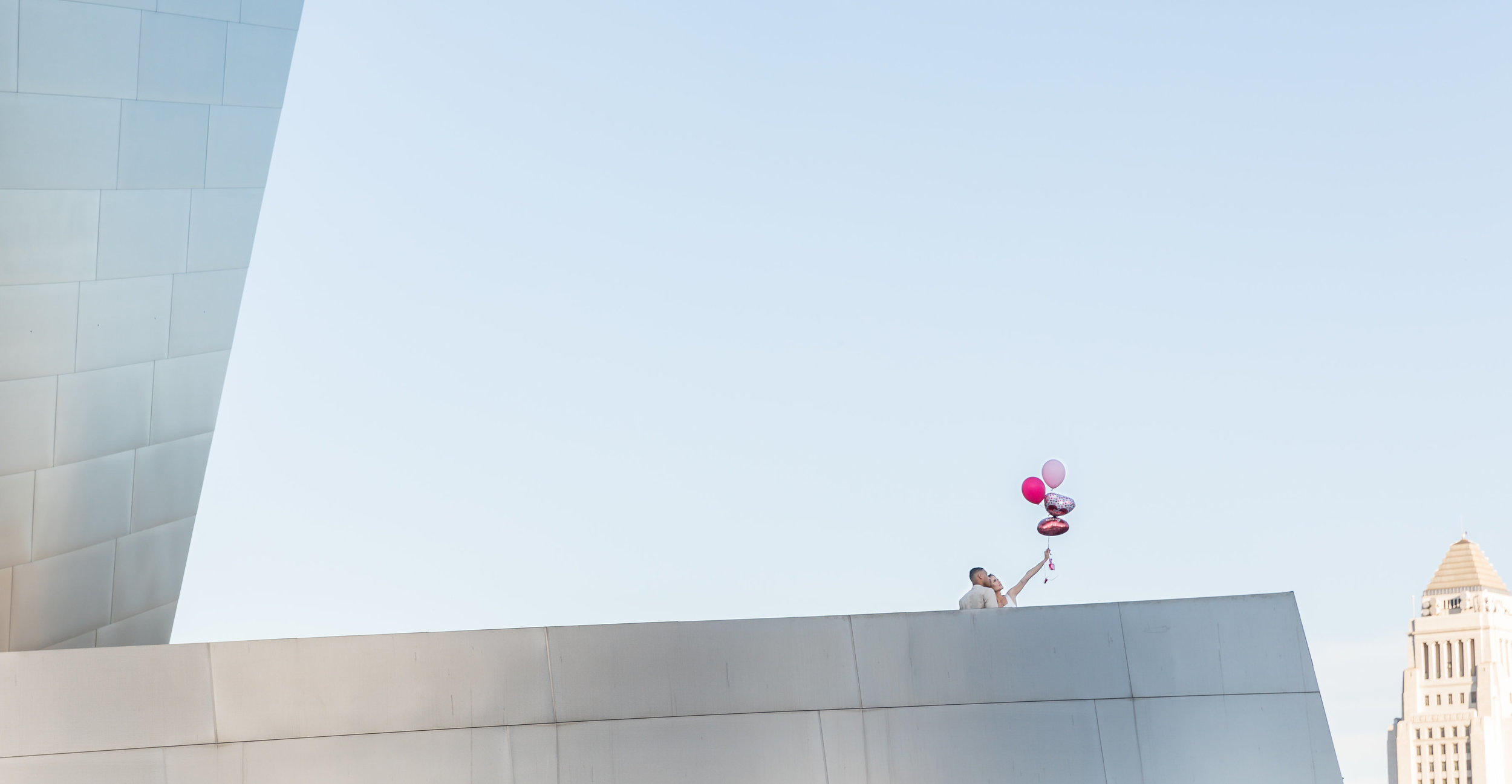 Engaged Couple Portrait with Balloons.jpg