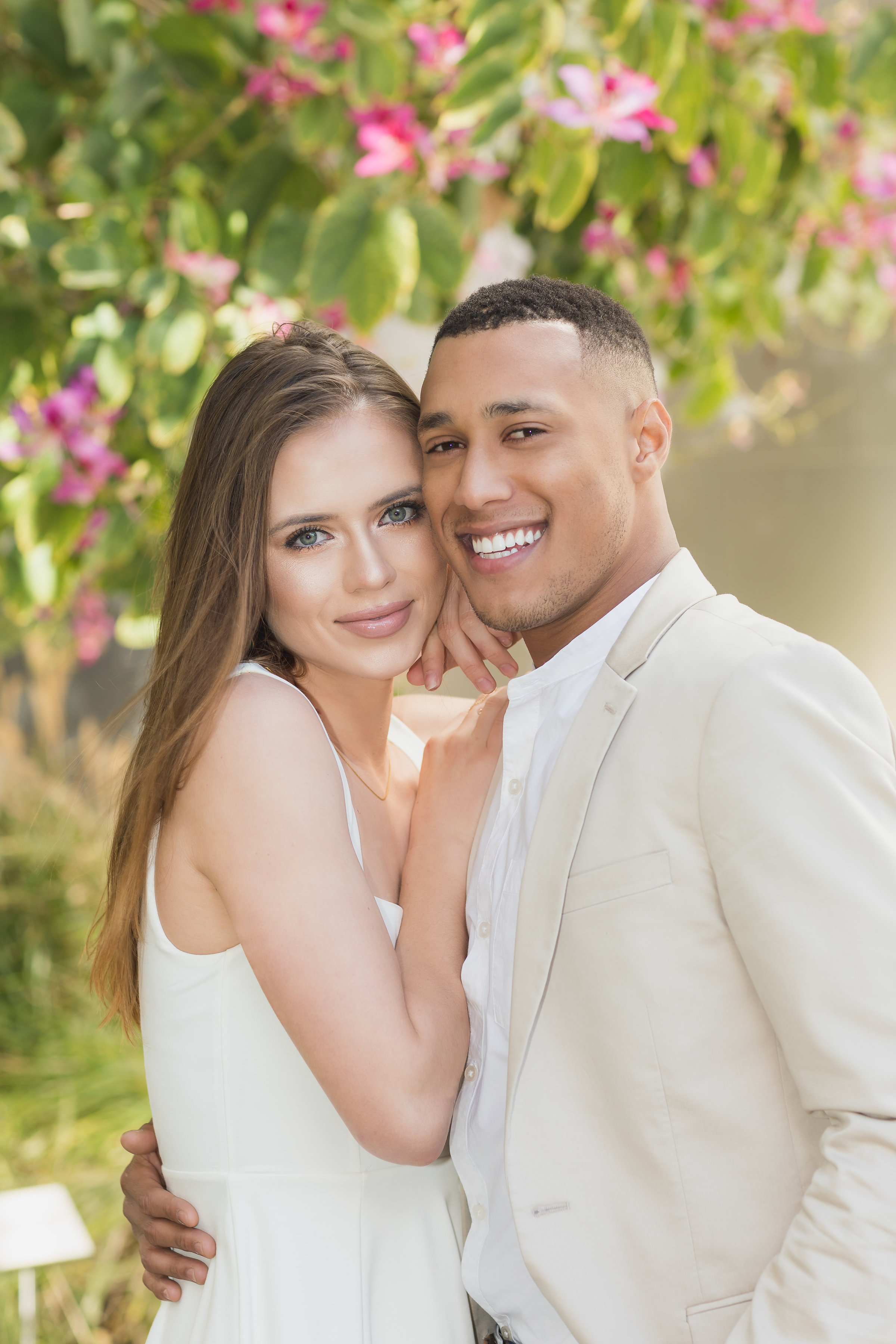 Beautiful couple surrounded by flowers for LA Engagement Photo Shoot.jpg