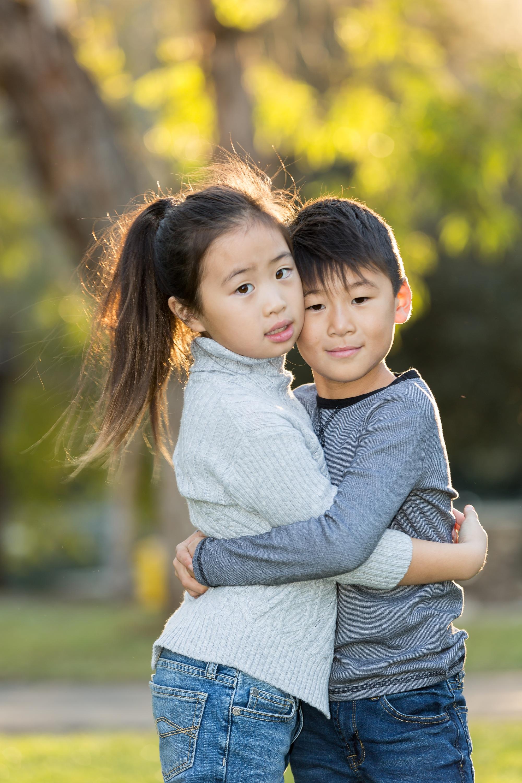 bro and sis hugs at irvine regional park.jpg
