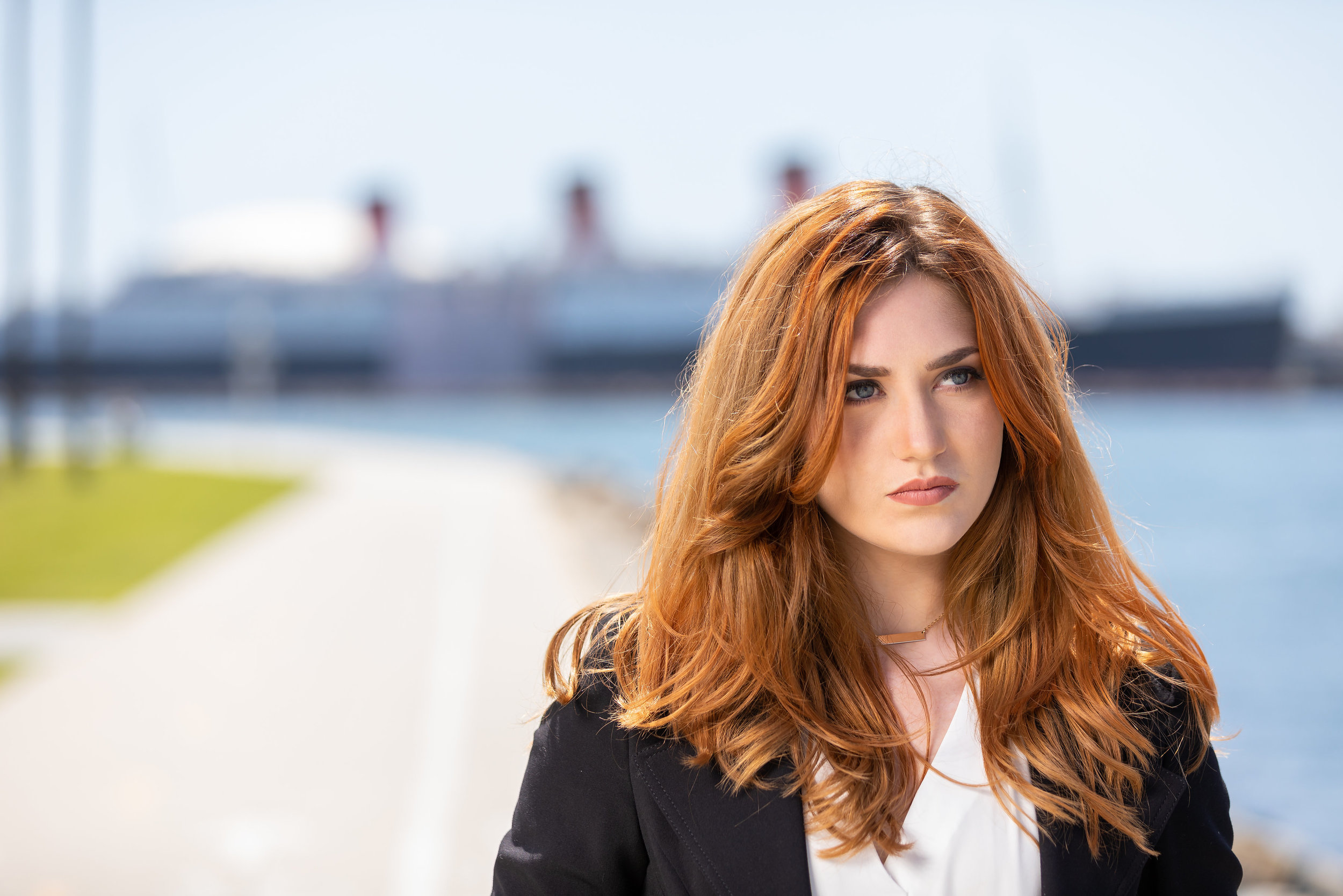 Brooding red headed woman model walking along the harbor.jpg