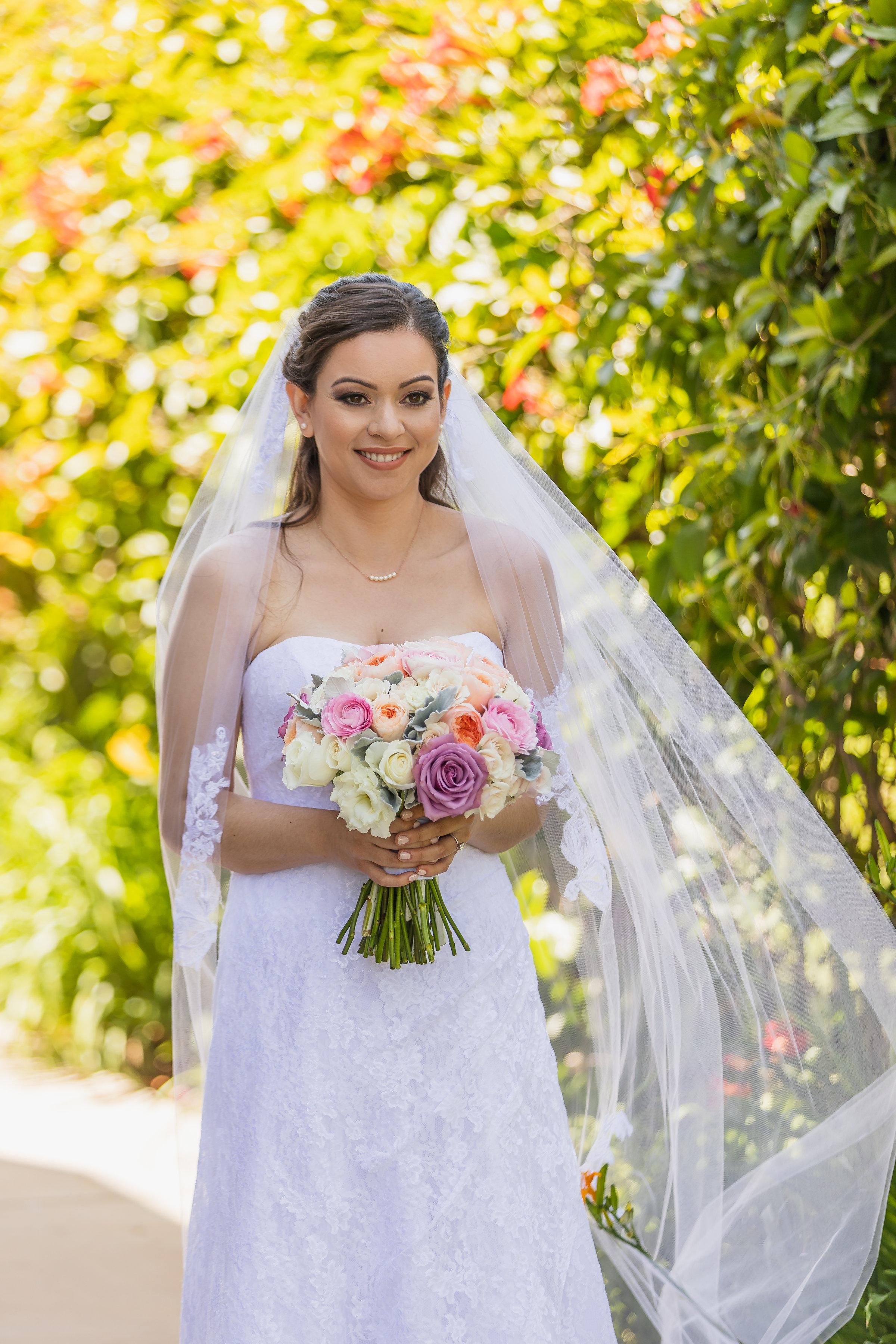 Bride walking to meet her groom in Huntington Beach.jpg