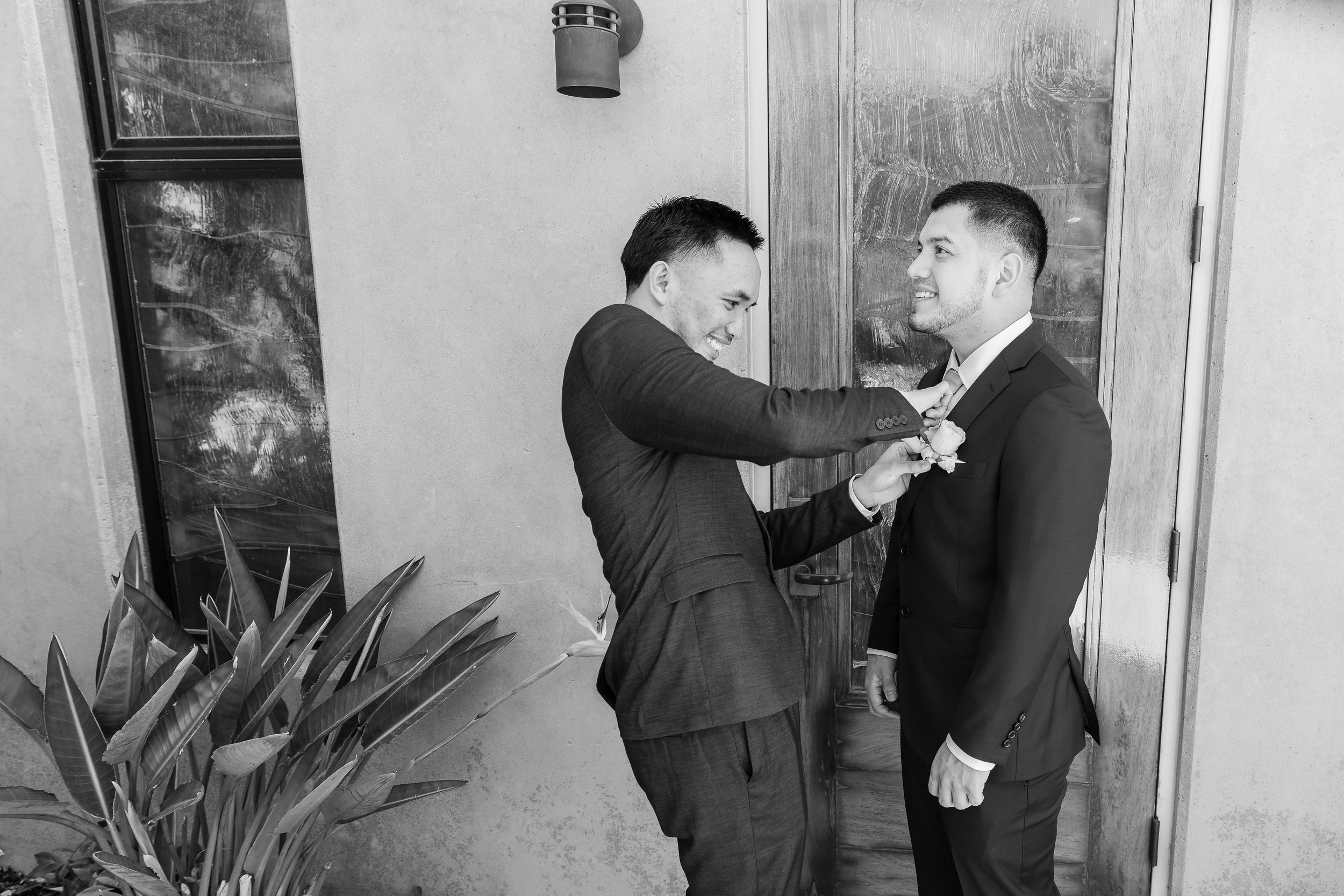 Best man getting the groom ready.jpg