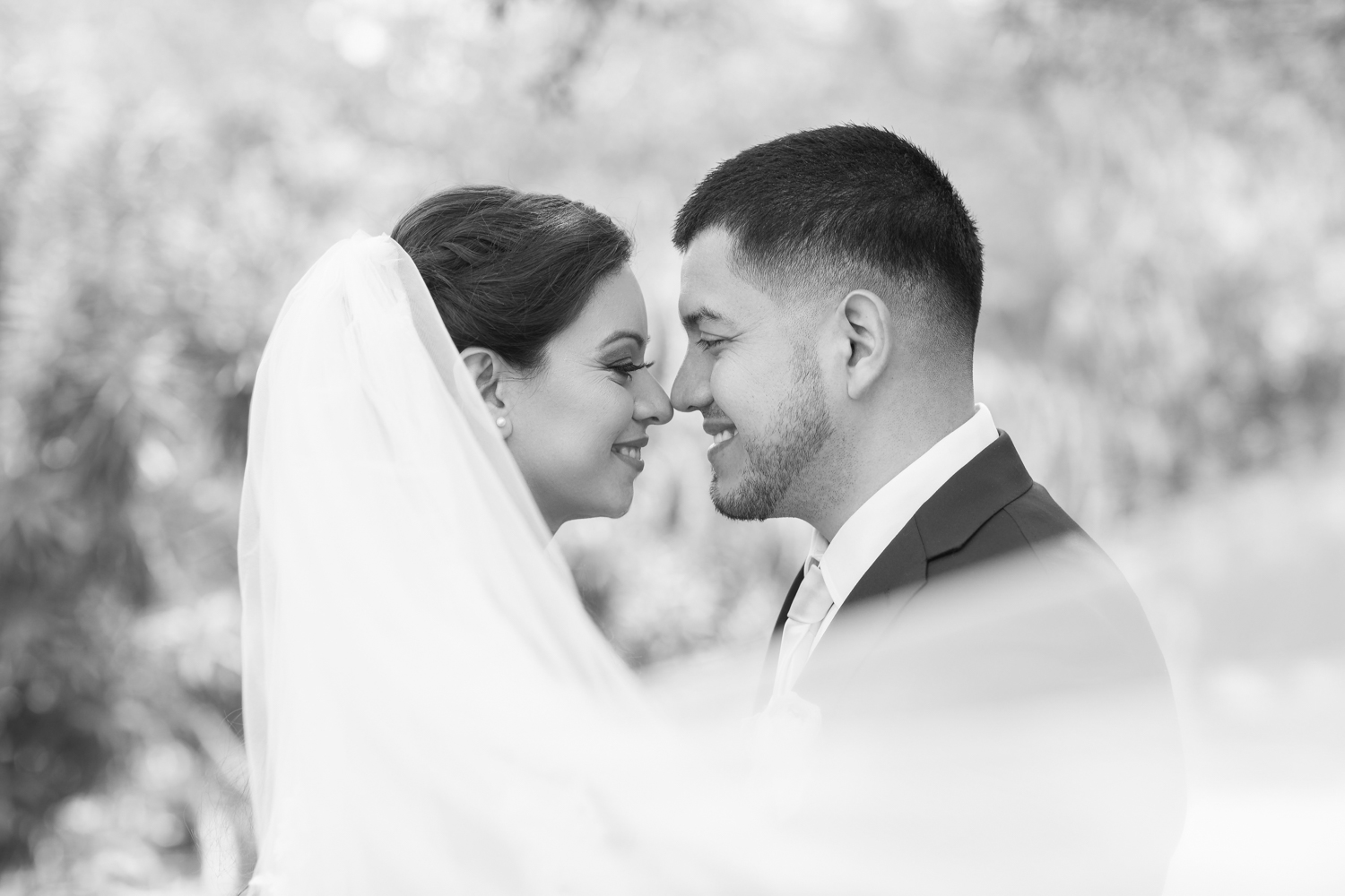 Bride and Groom Black and White Portrait wrapped in veil.jpg.jpg