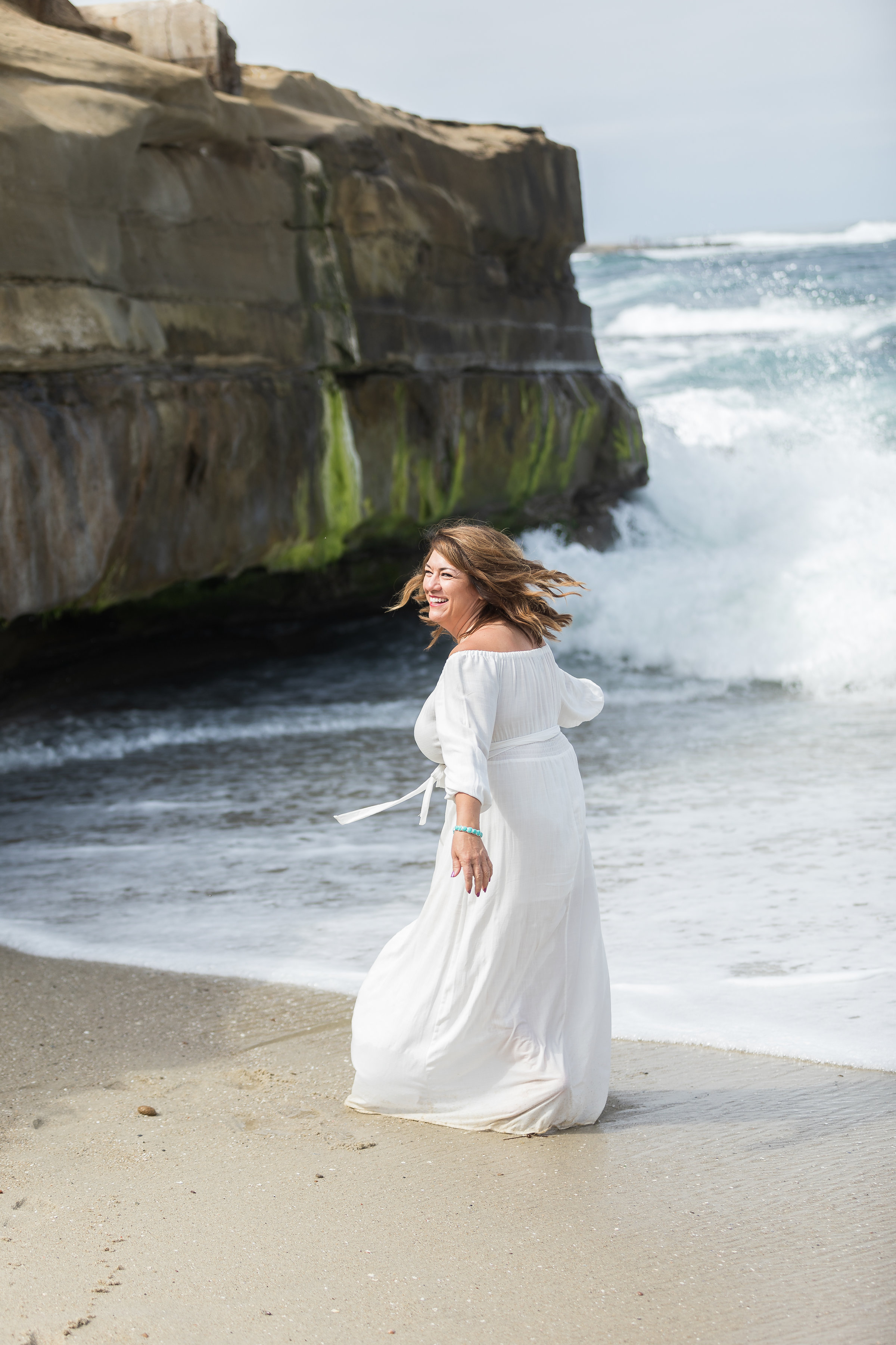 Mom playing in the ocean with long white dress.jpg