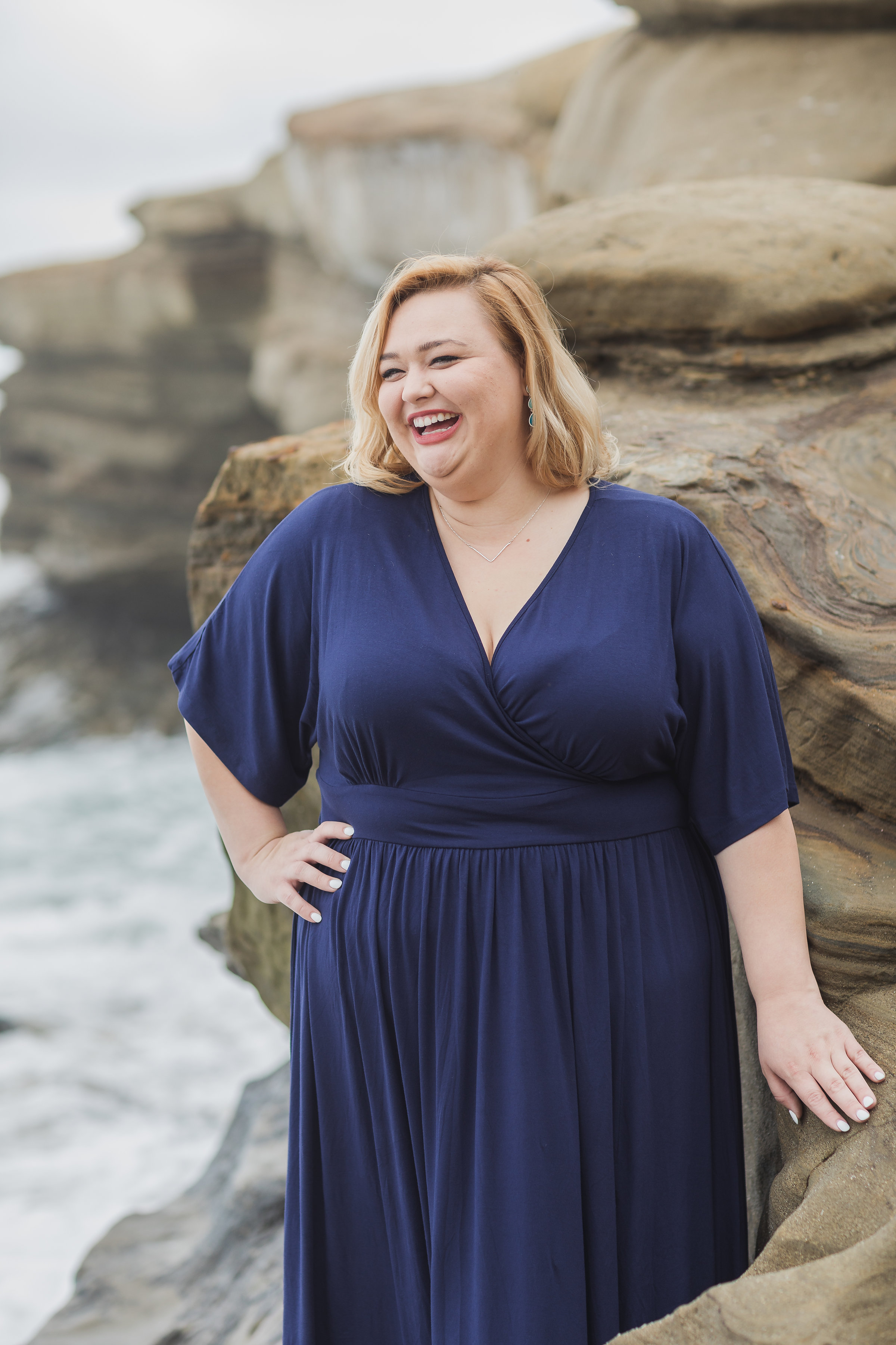 Laughing gal in blue dress and the beach.jpg