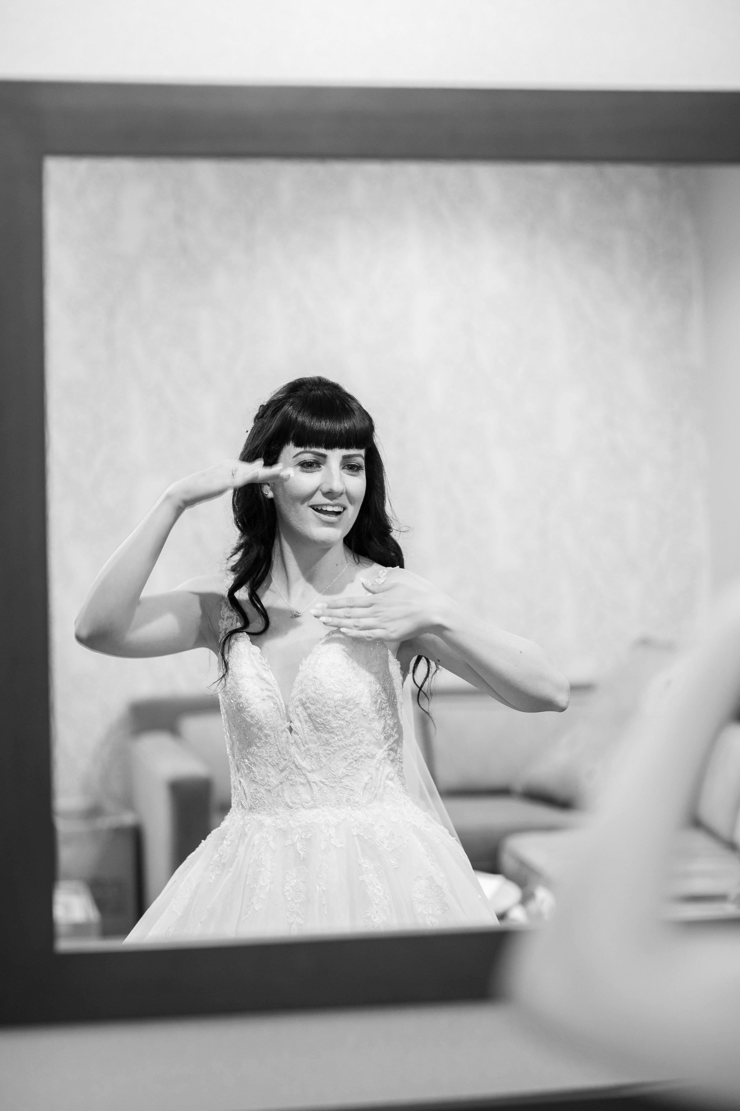 Photo of bride having fun getting ready.jpg