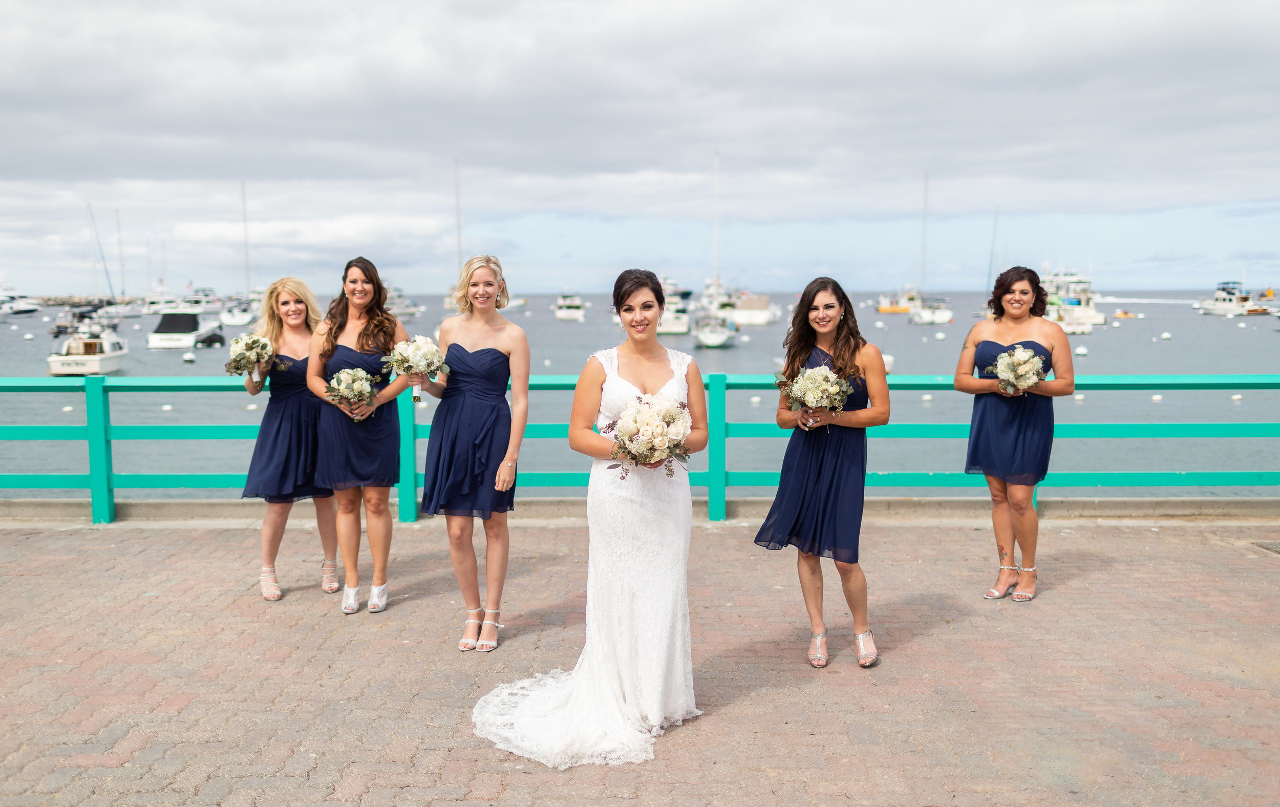 Bridesmaids in Blue Photo Pose with Bride.jpg