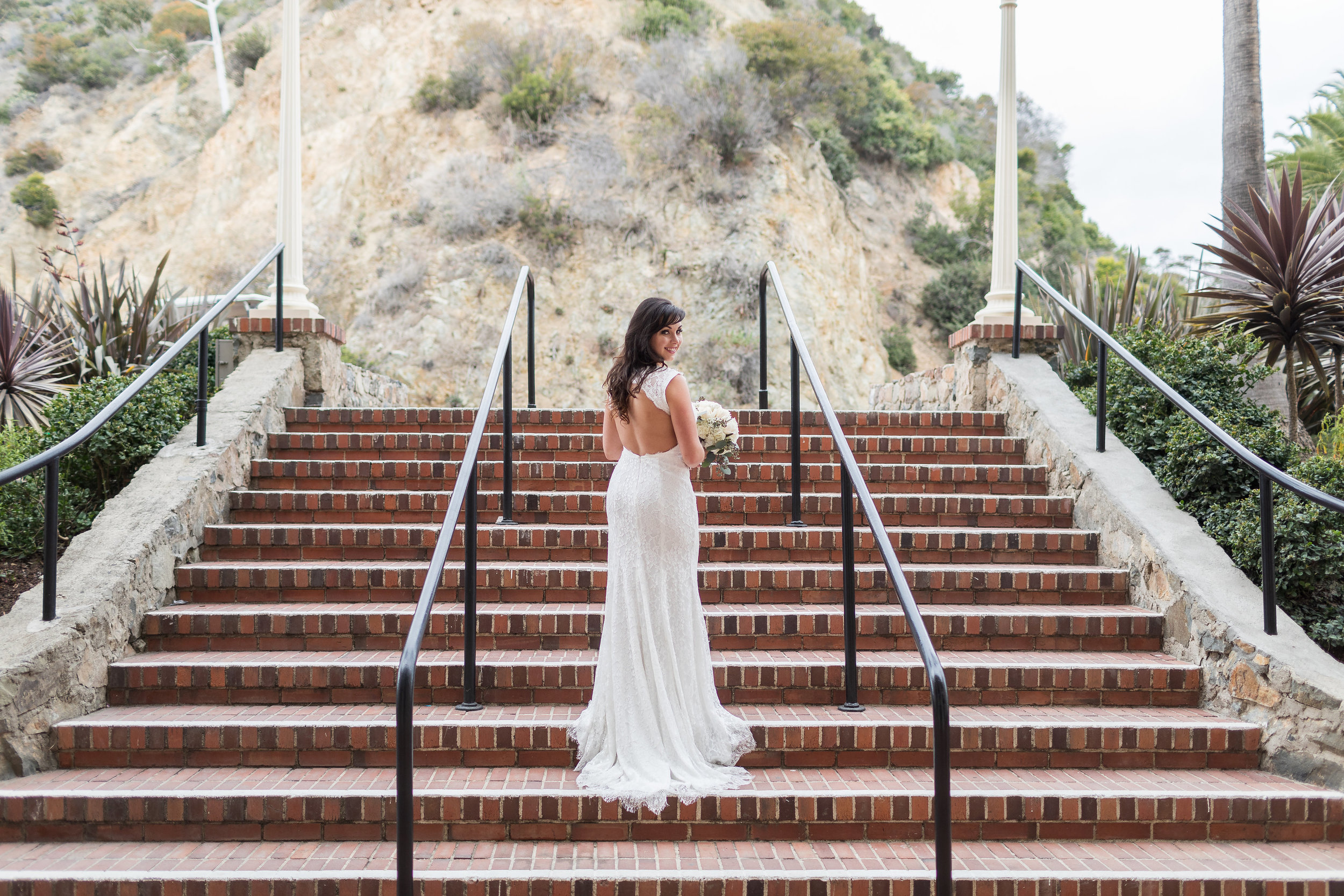 Photography Pose of Bride on Stairs Looking back over shoulder.jpg