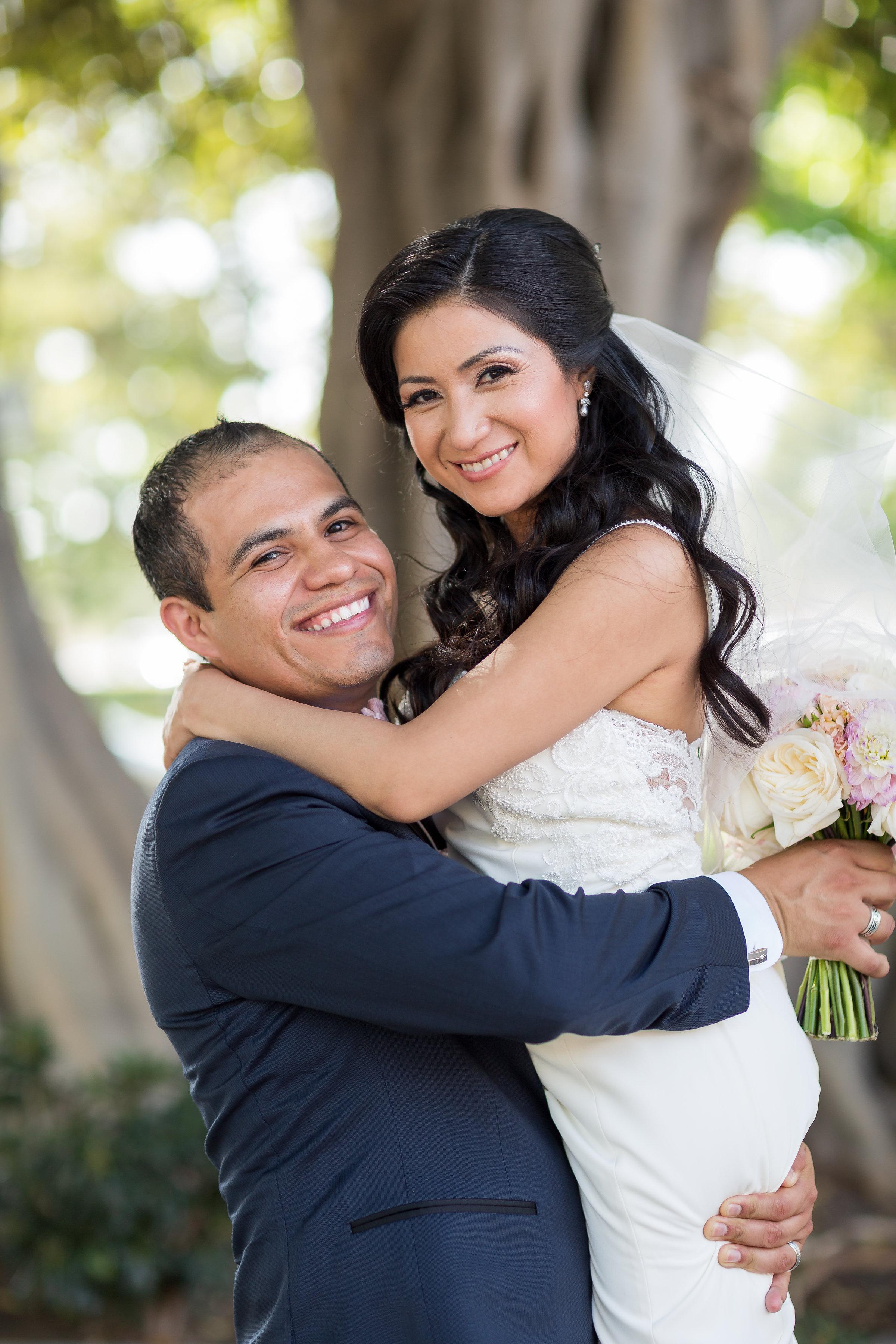 Photo of Happy Groom Lifting Happy Bride.jpg