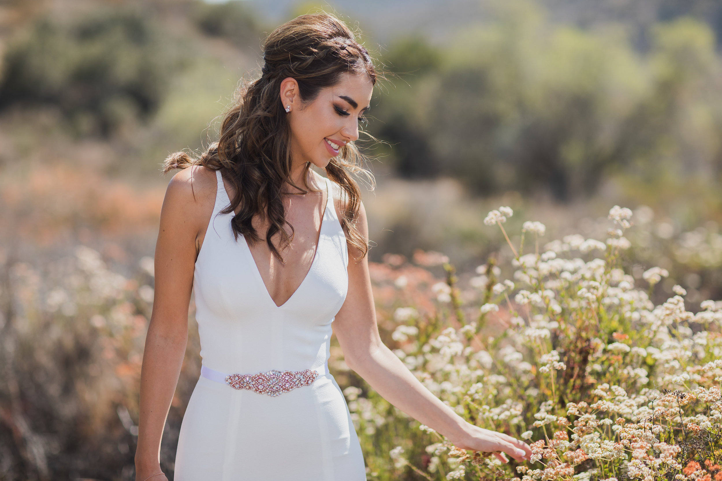 Photo of Bride walking among the desert flowers.jpg