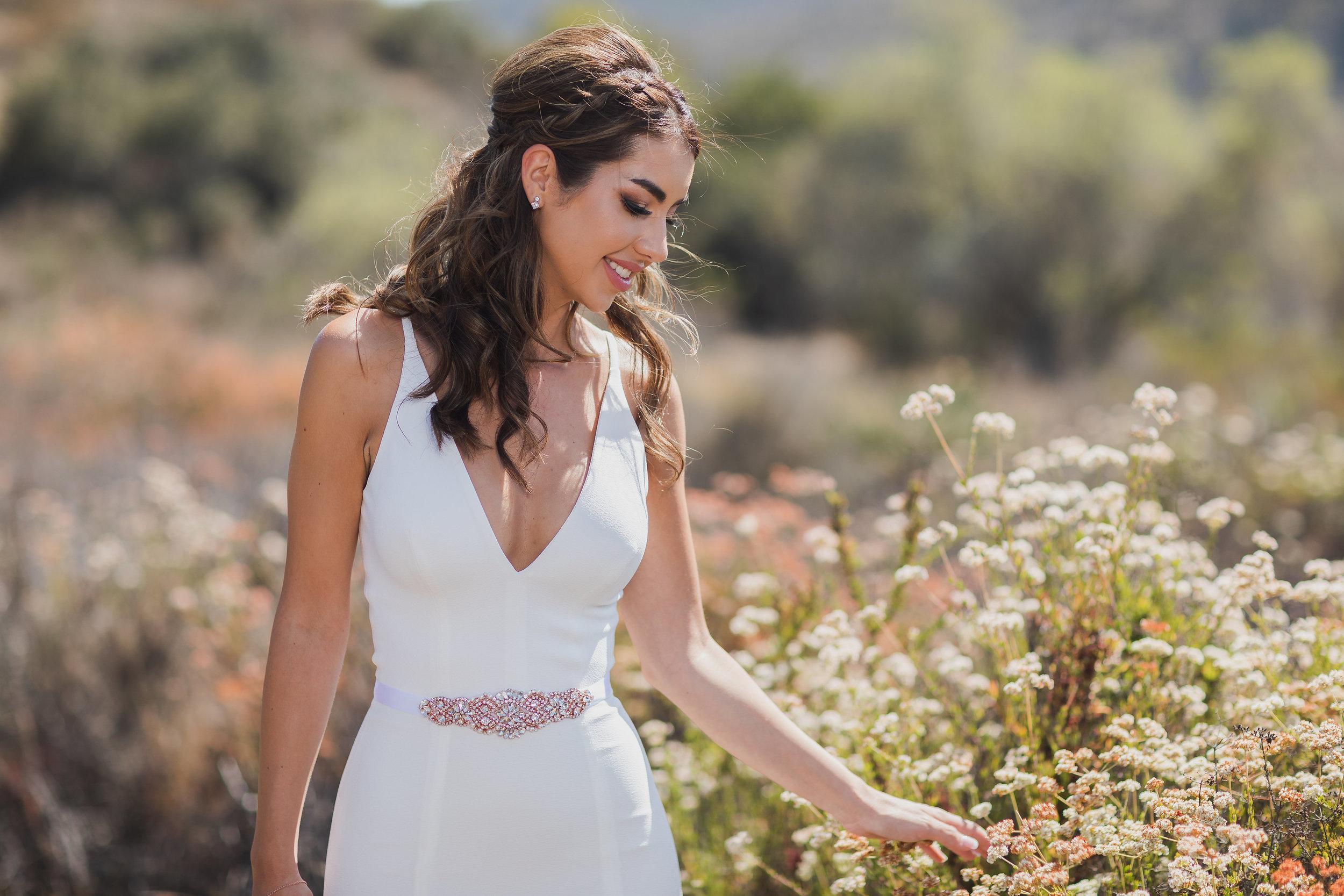 Photo of Bride walking among the desert flowers.jpg