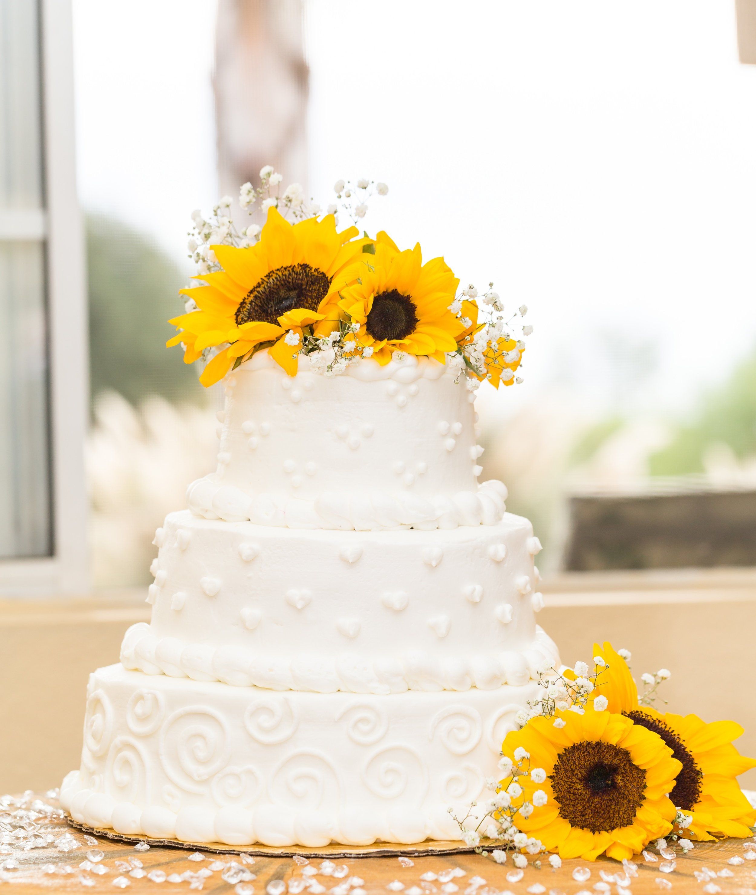 Photo of White Country Wedding Cake with Sunflowers.jpg